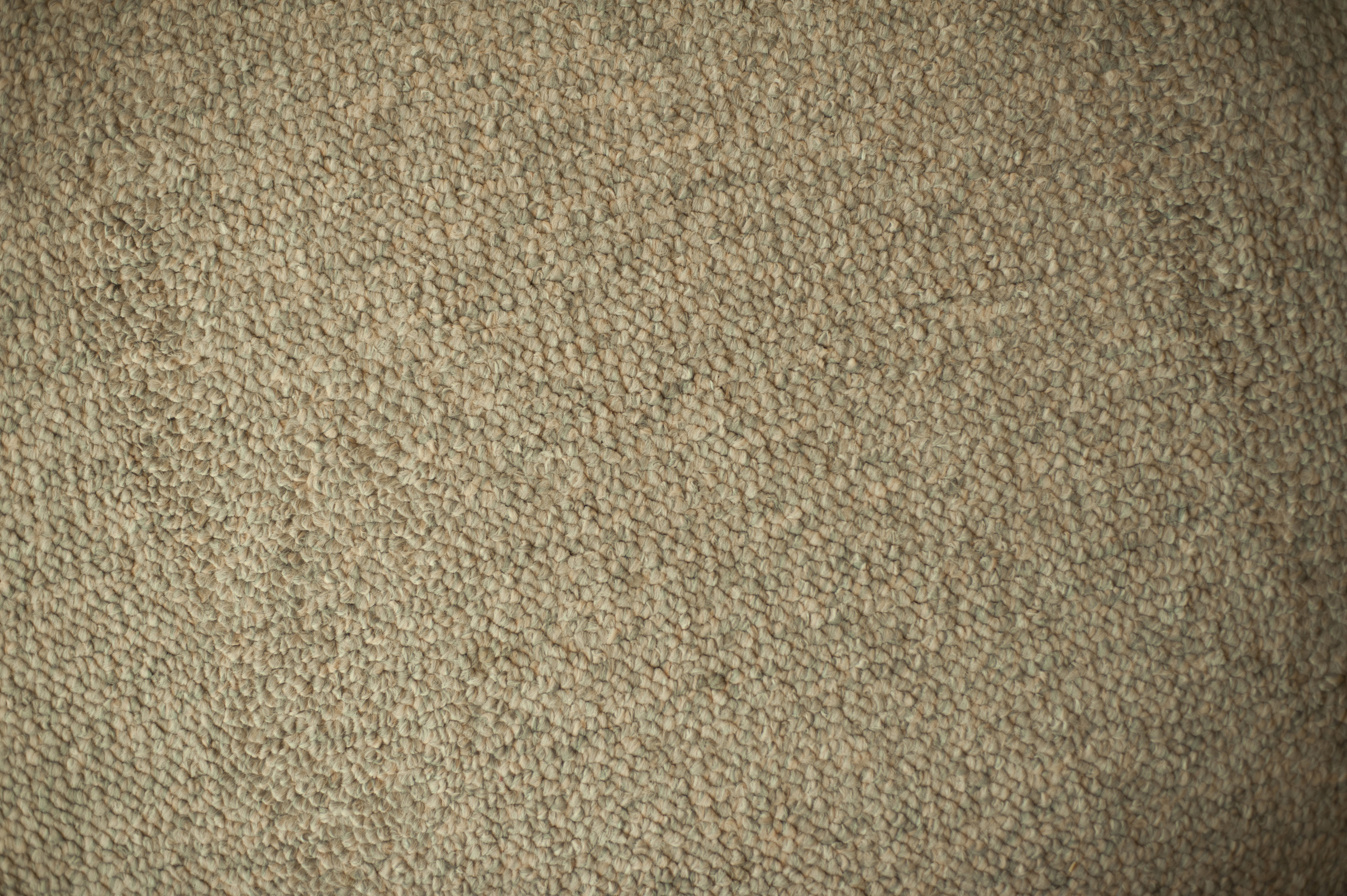 Details of Textured Beige Carpet for Wallpaper Backgrounds, Emphasizing Copy Space.