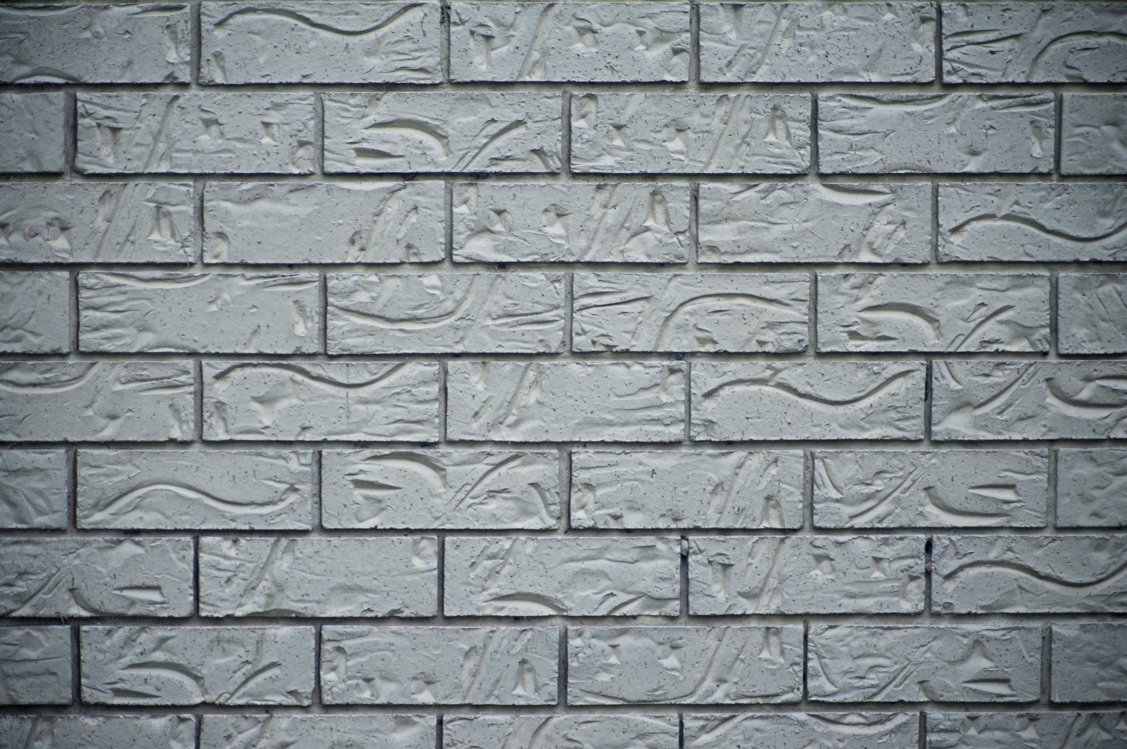 Decorative Grey Brick Background Of Incised And Patterned Grey Bricks In A  Neat Wall Construction,
