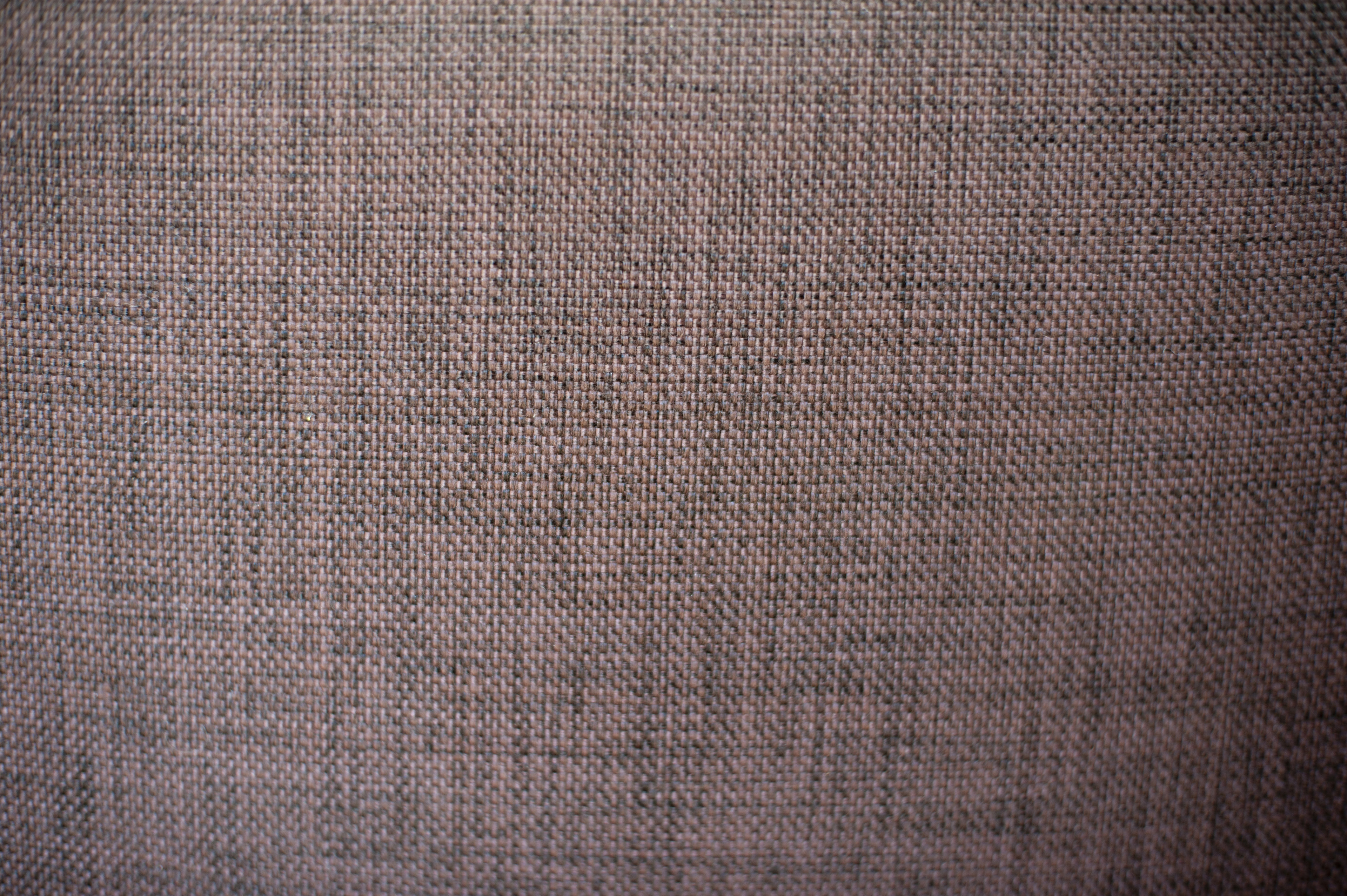 woven textile background texture in muted purple