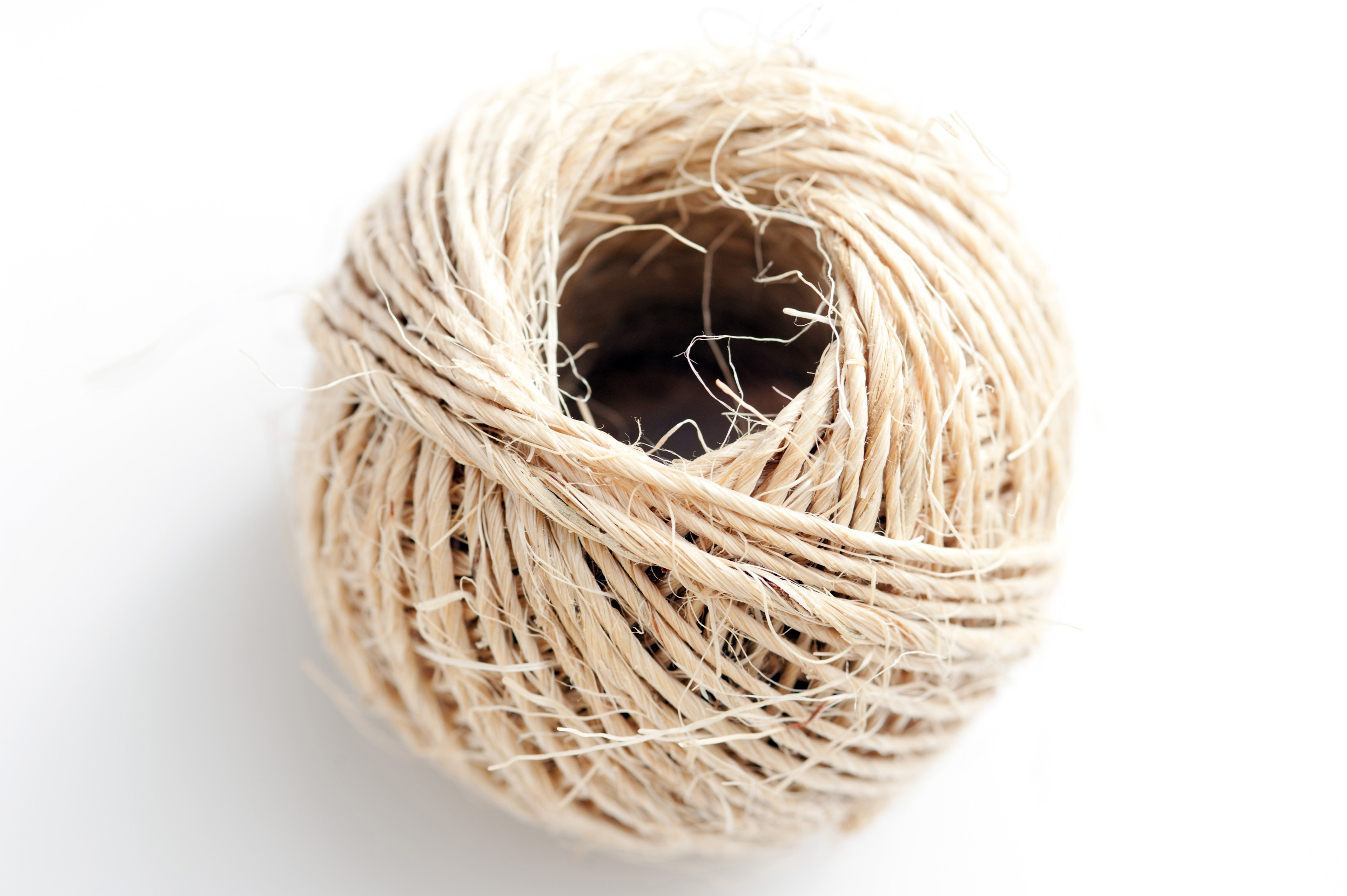 Close up Aerial Shot of Ball of Twine Isolated on White Background