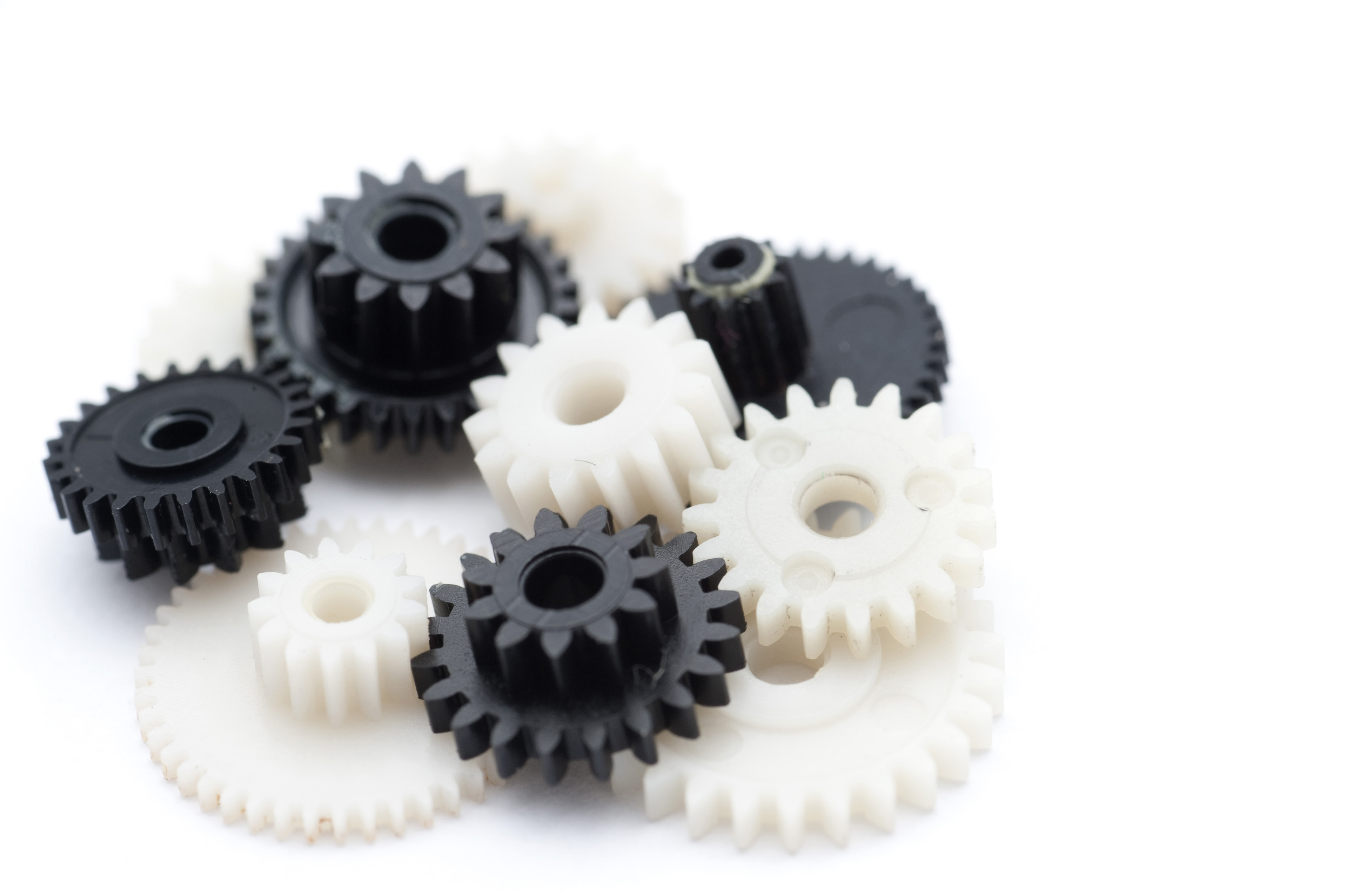 Close up Black and White Plastic Cog Gears Isolated on White Background.