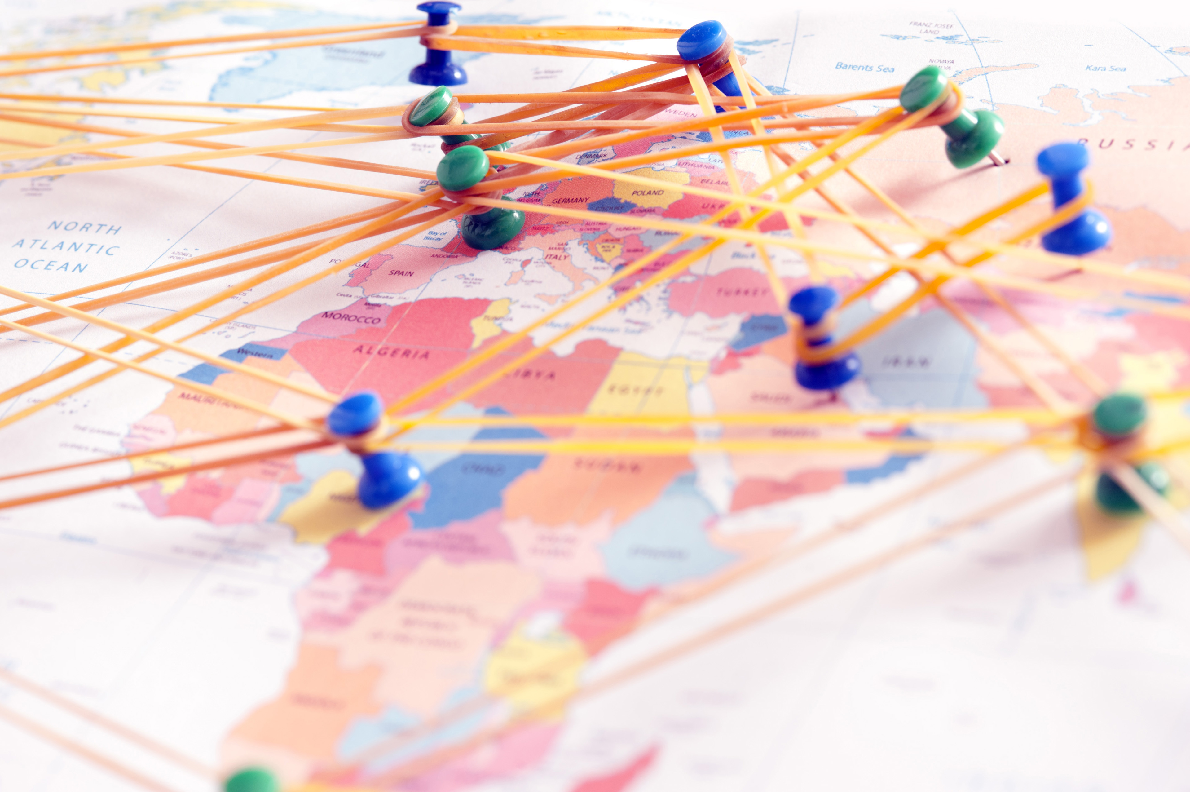 Conceptual image of pins on a map depicting international connections, communications and travel