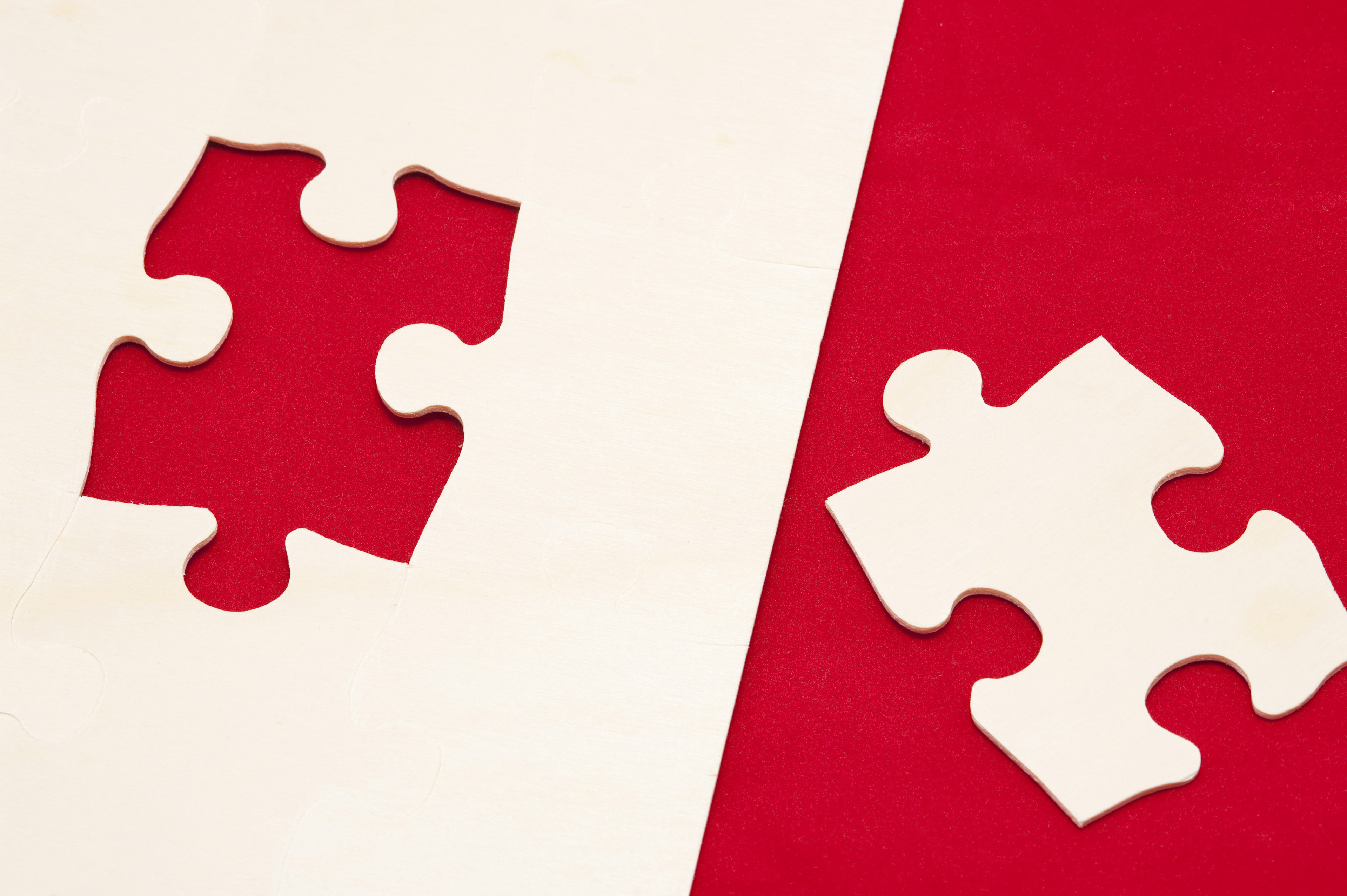 Close up Shot of Red and White Jigsaw Puzzle Game, Emphasizing Problem Solving Concept