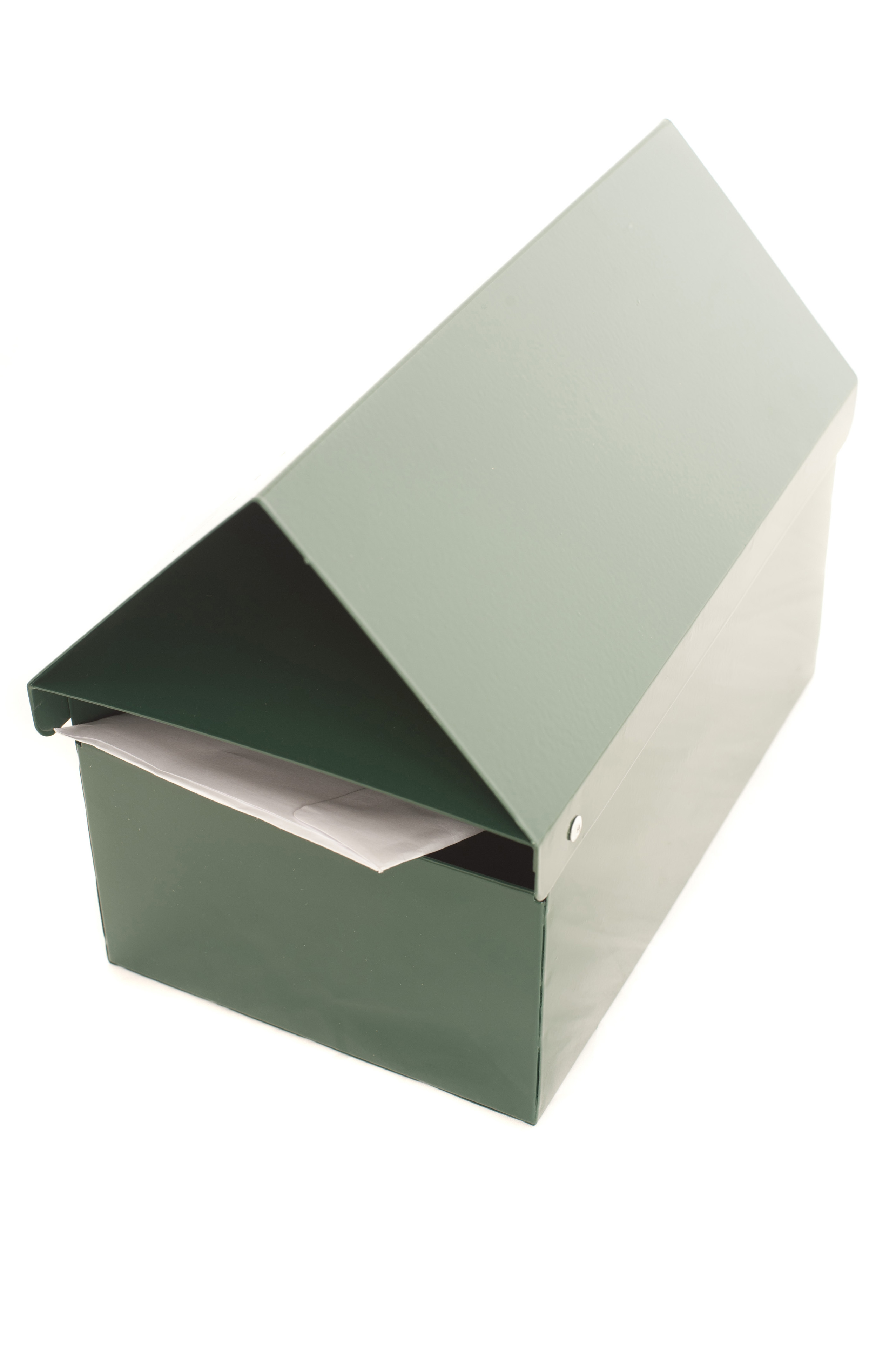 View from Above of Elongated Green Mailbox in Shape of House with Letter Peaking from Slot on White Background