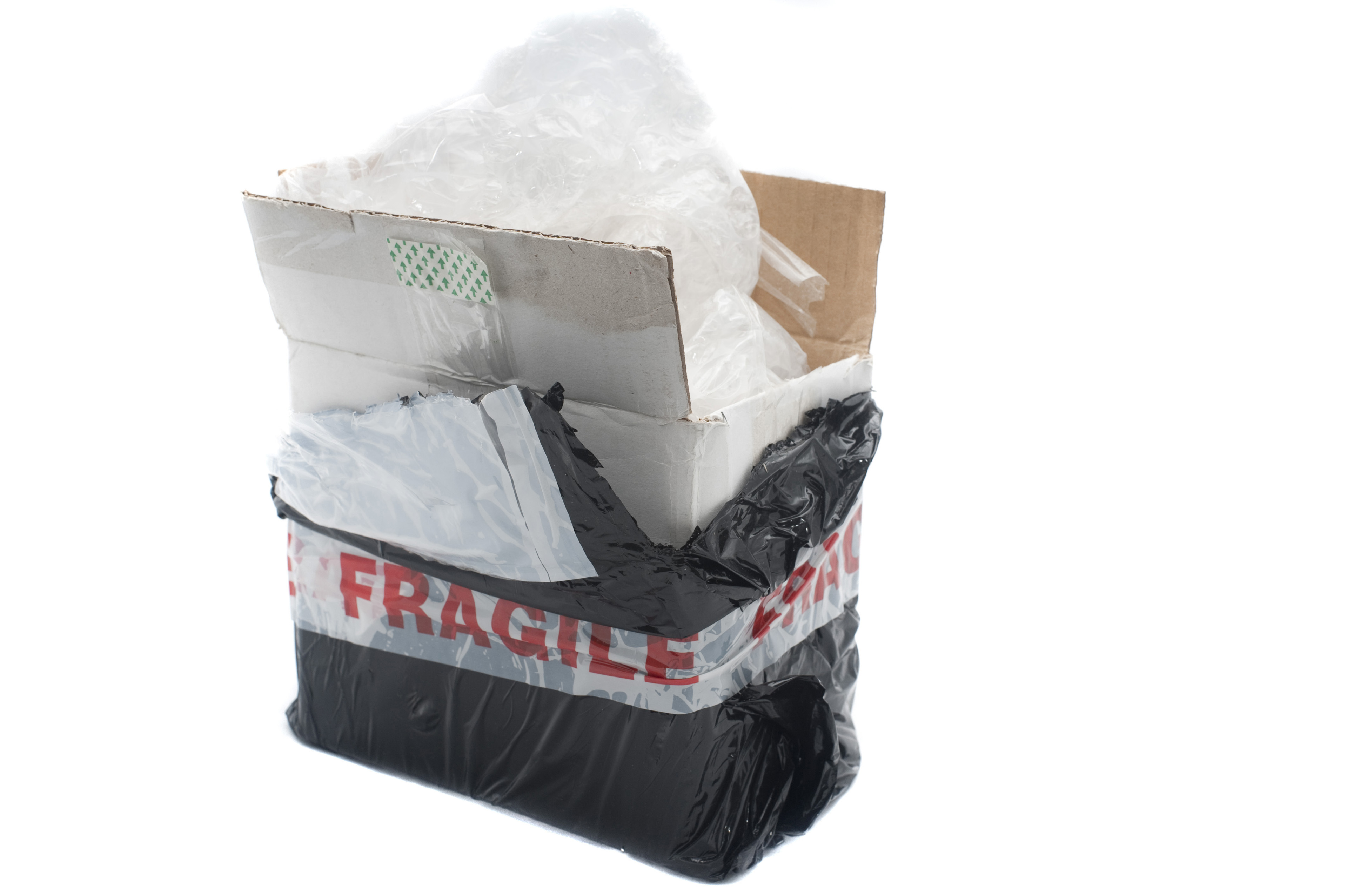 Opened cardboard box postal or courier package with fragile sticker and interior packaging isolated on white