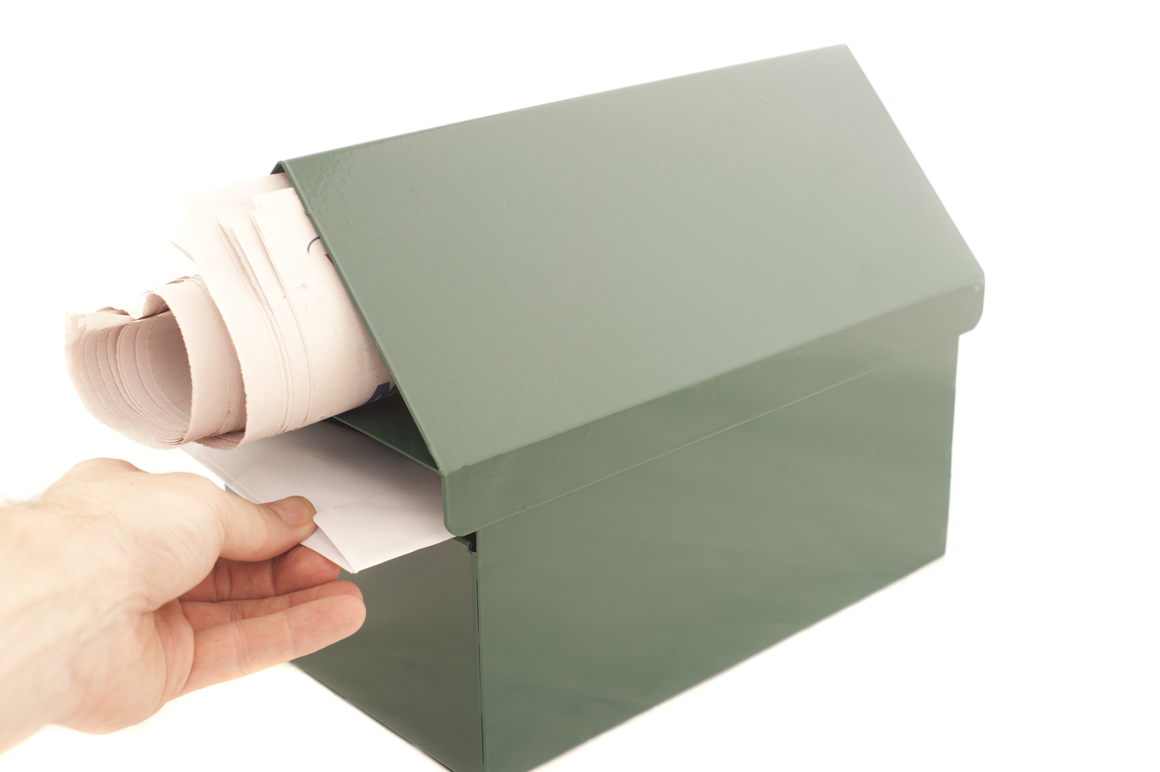 Conceptual Human Hand Pulling a Mail From the Box. Isolated on White Background. Emphasizing Copy Space.