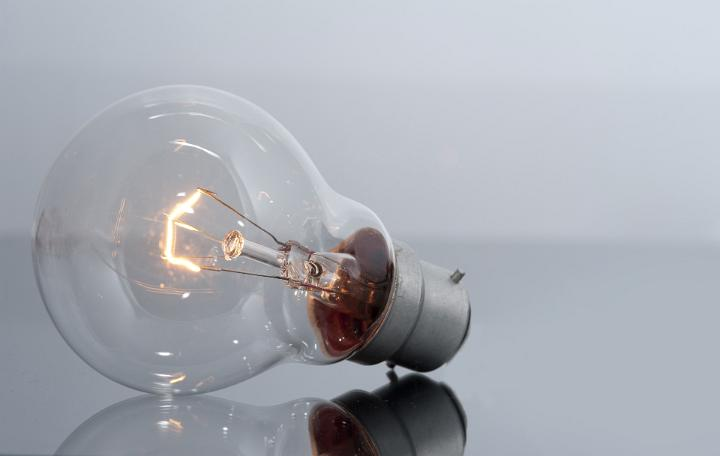 Clear Light Bulb with Glowing Filament by freebie.photography
