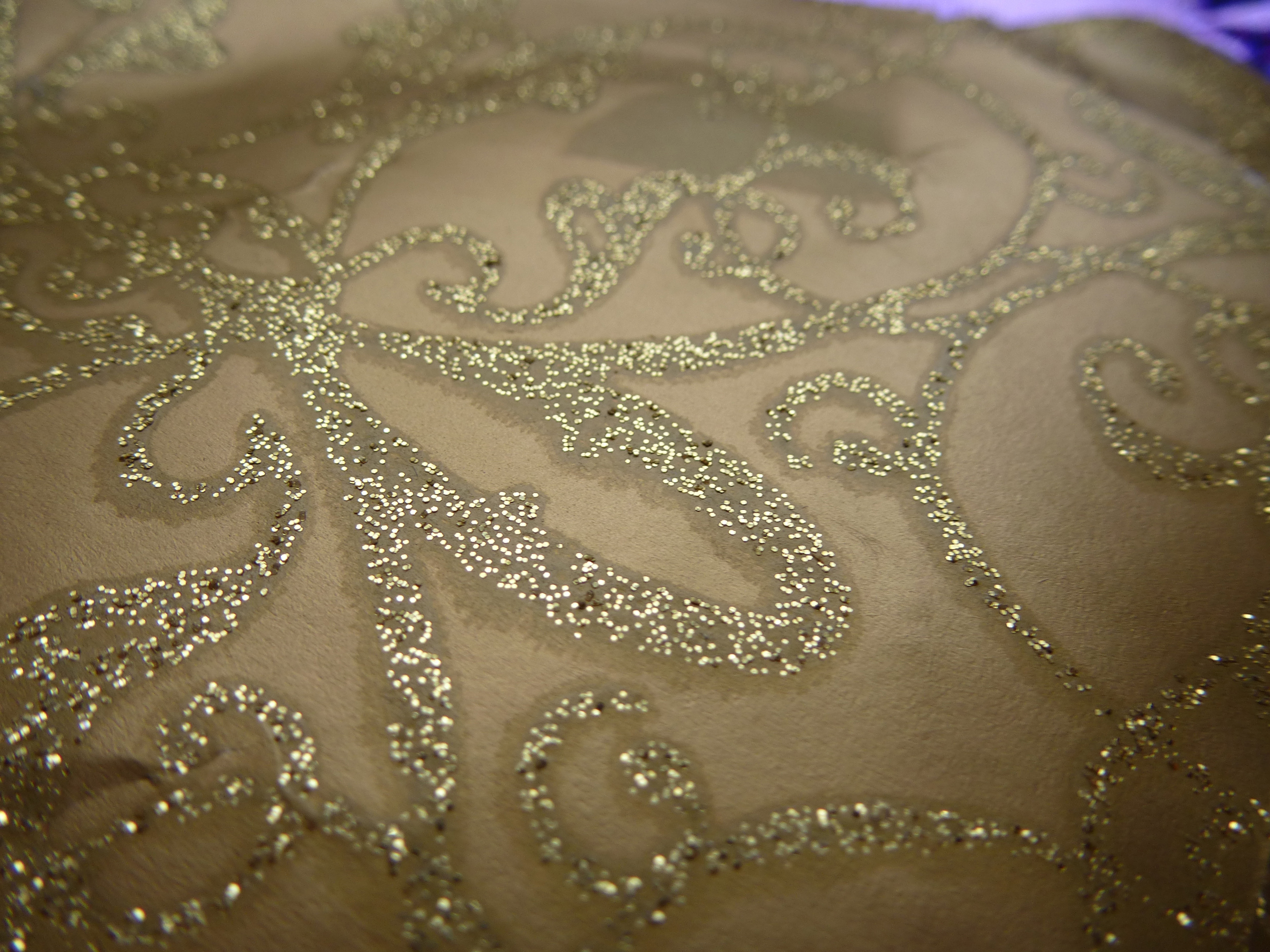 Close up Artistic Glittering Gold Design on Brown Background for Backdrop.
