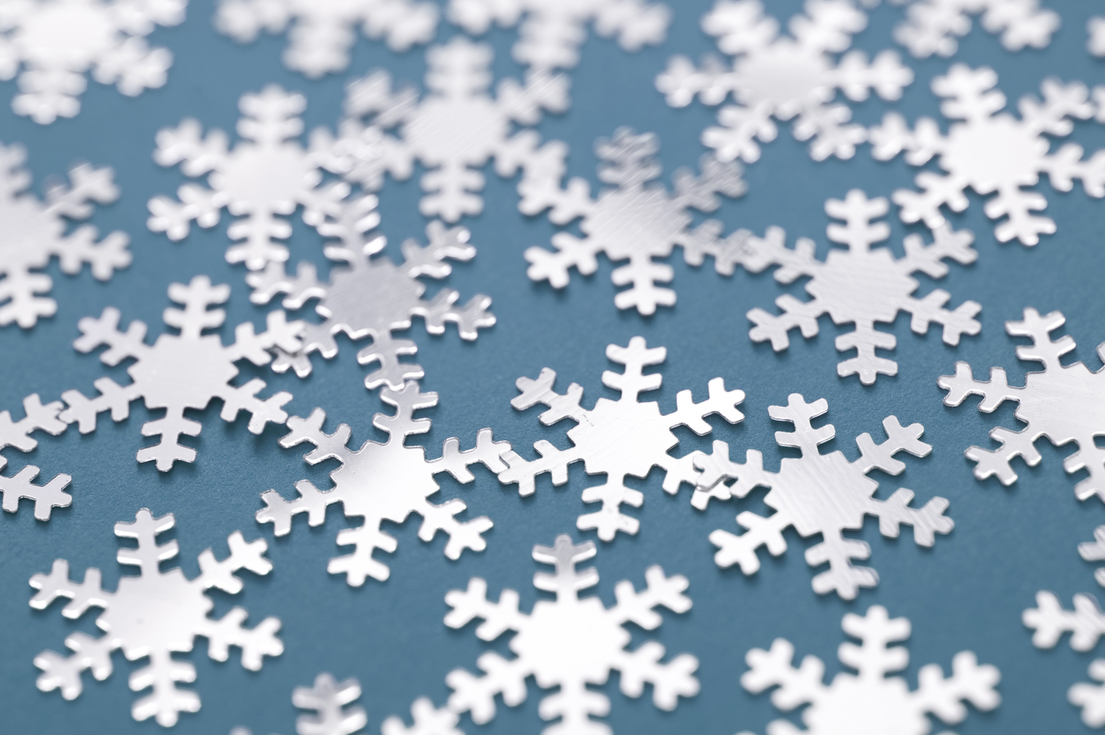 Close up Snowflakes Pattern on Blue Gray Background for Wallpaper Designs.
