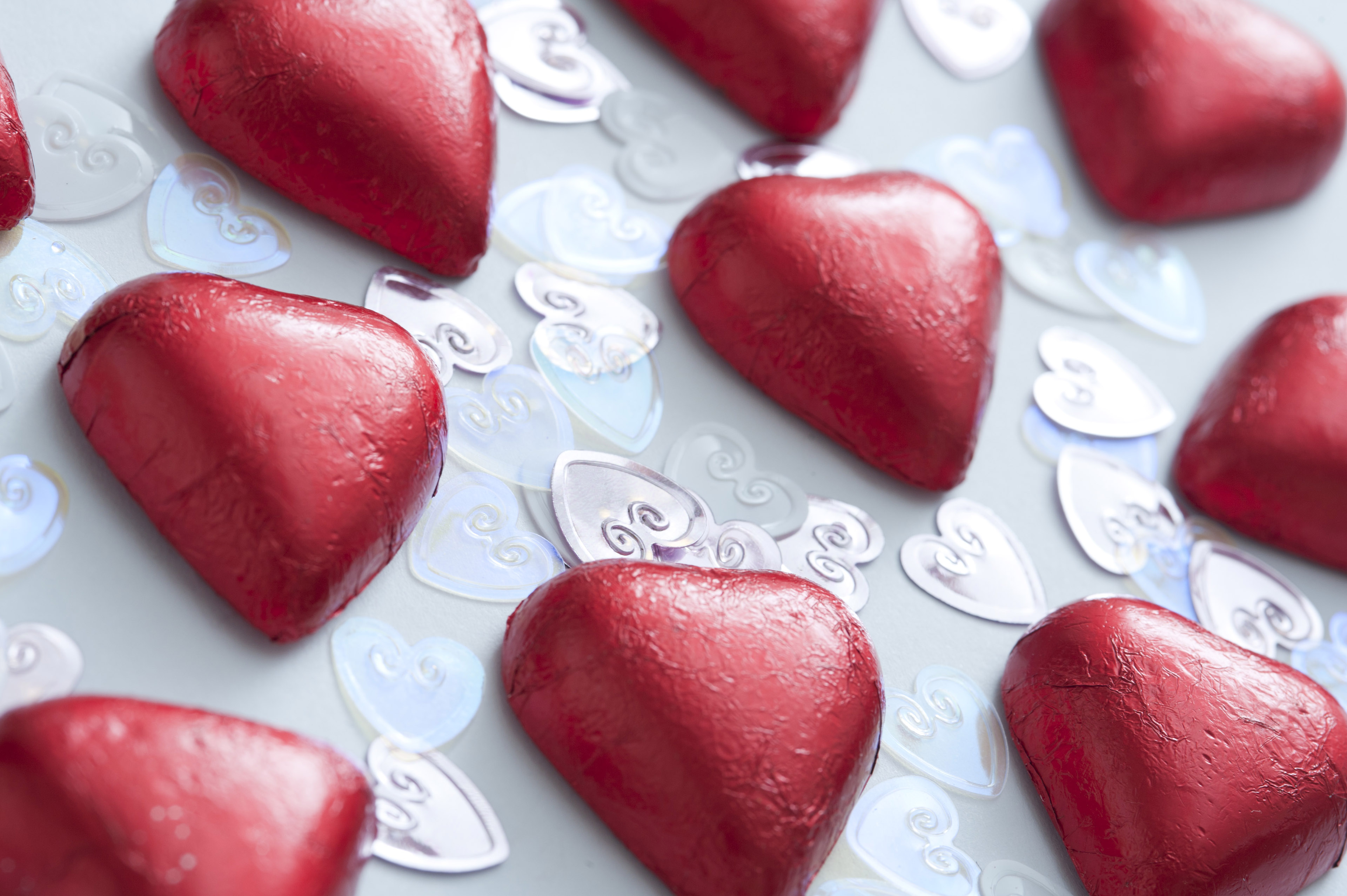 Rows of valentine heart-shaped chocolates in close-up