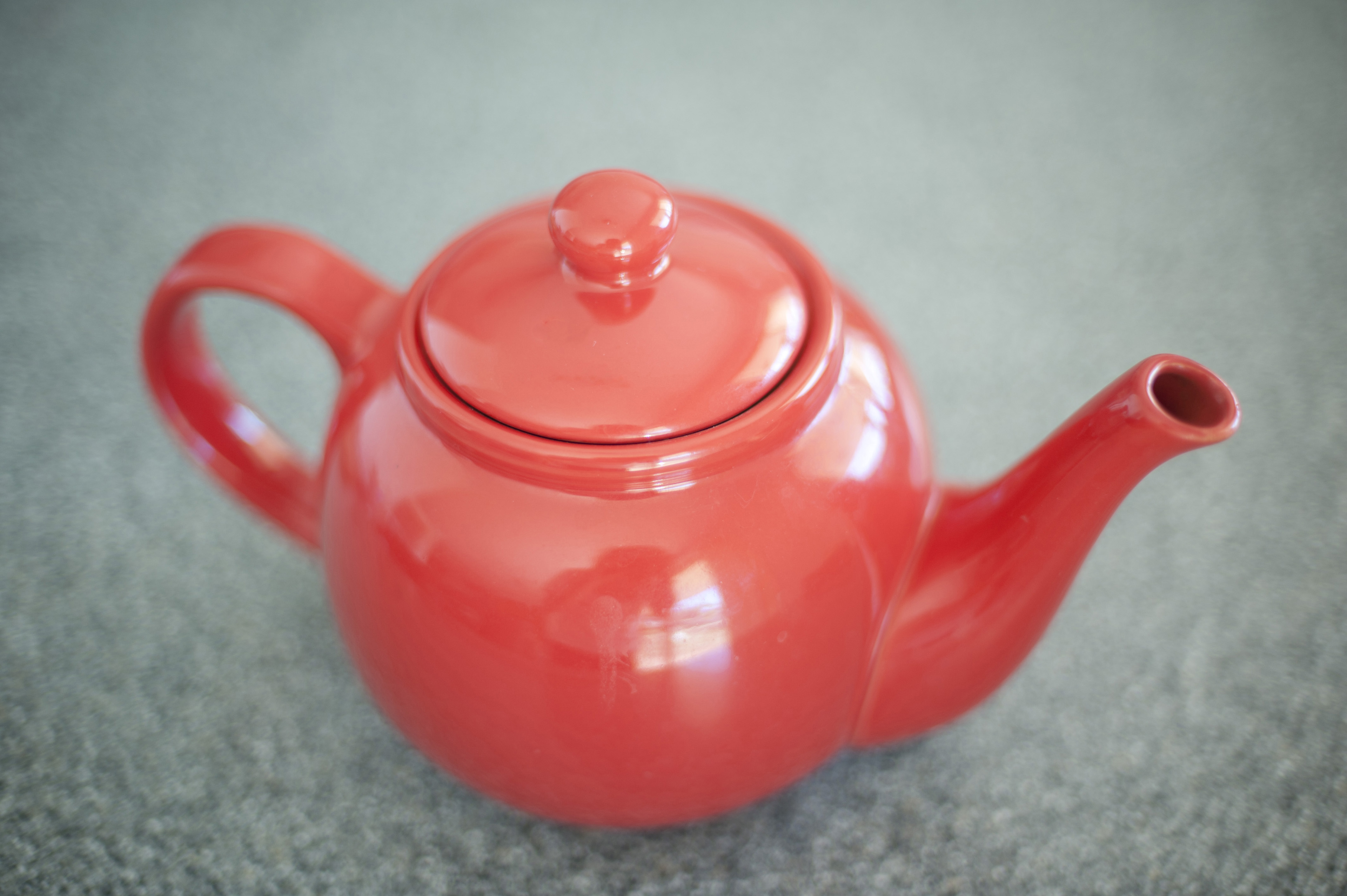 Still Life of Red Teapot on Counter Top as seen from Above