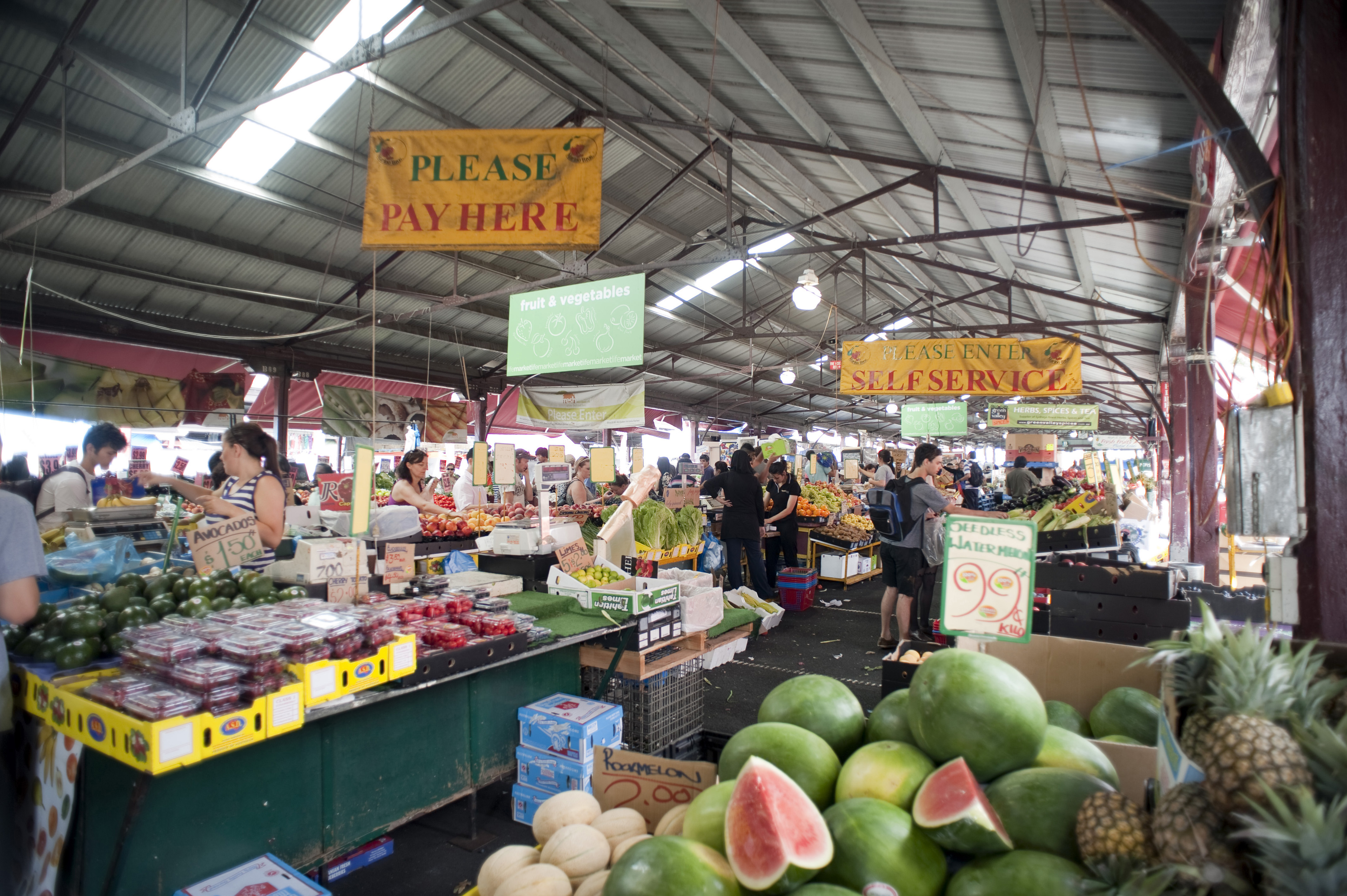 Extensive View of Random People Busy at Fresh Fruit and Vegetable Market