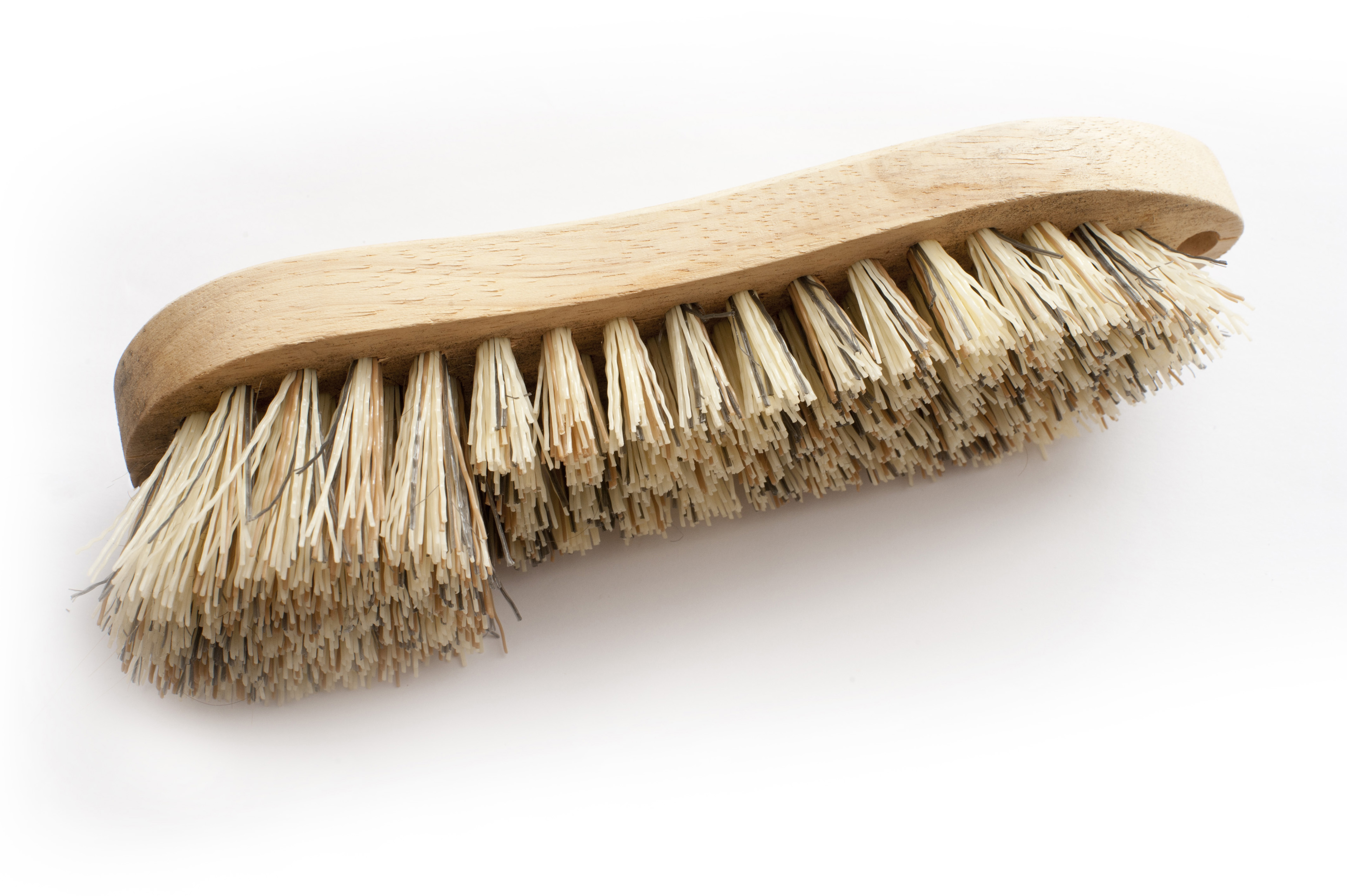Still Life of Single Cleaning Scrub Brush with Bristles of Various Lengths on White Background from Above