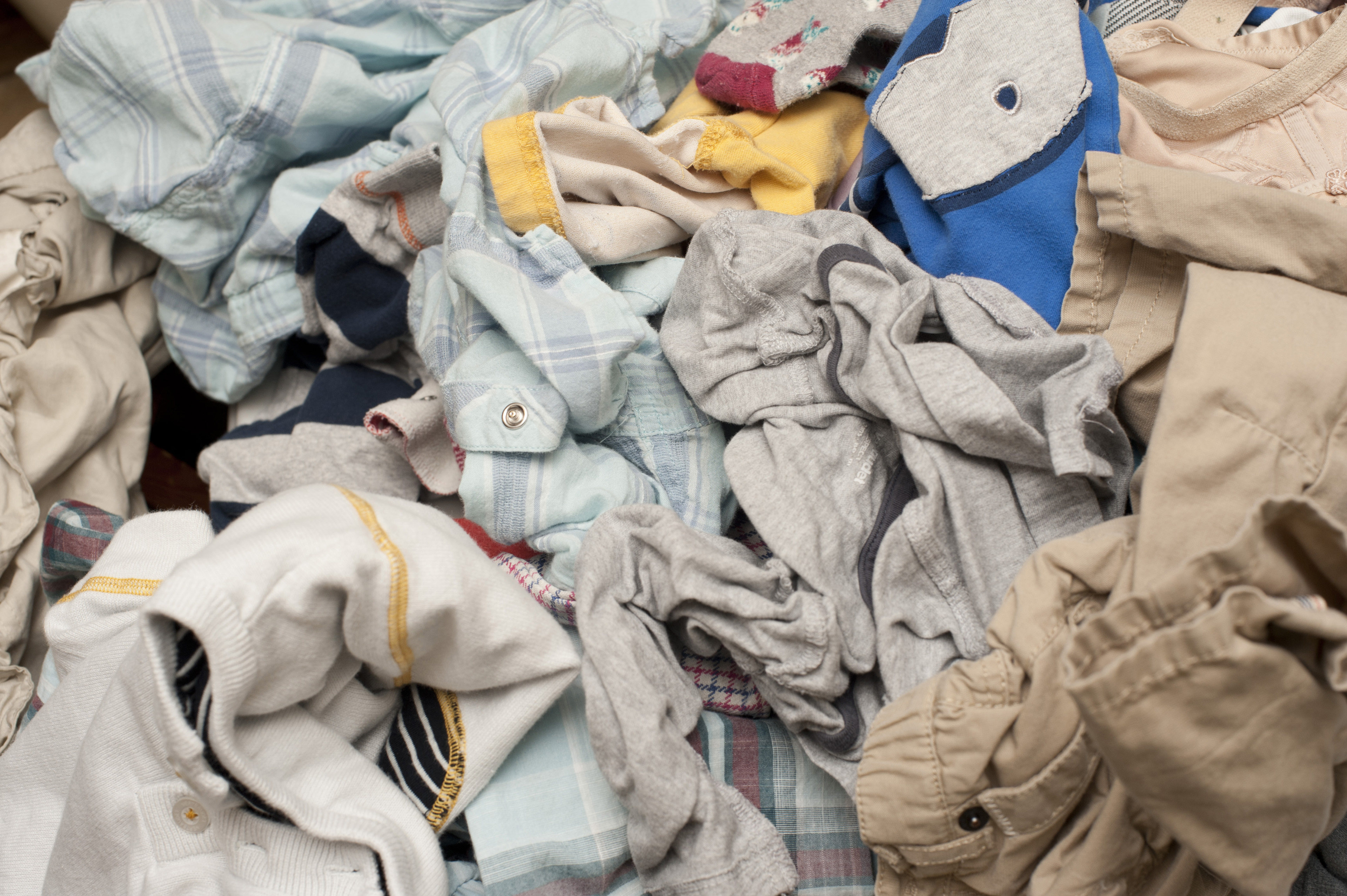Background texture of a pile of dirty laundry or washing with jumbled clothing