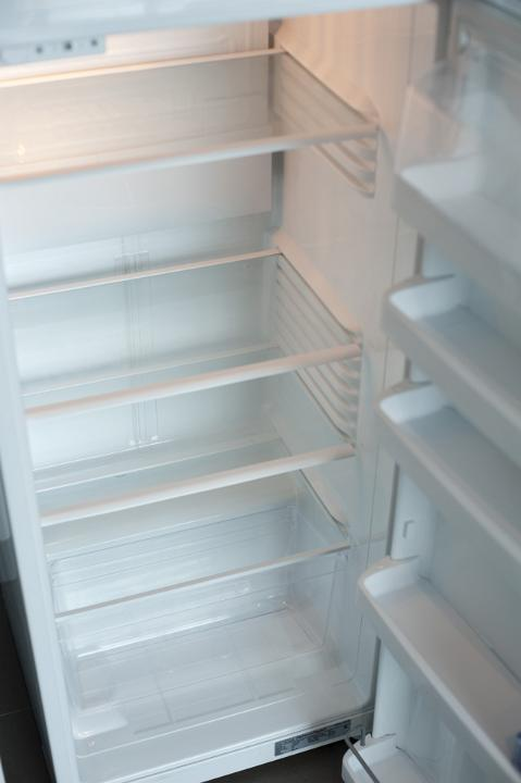 Interior of an empty fridge by freebie.photography