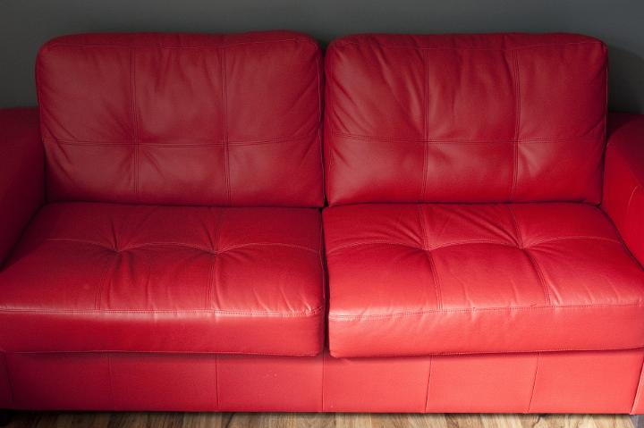 Image Of Elegant Red Leather Sofa In A Living Room