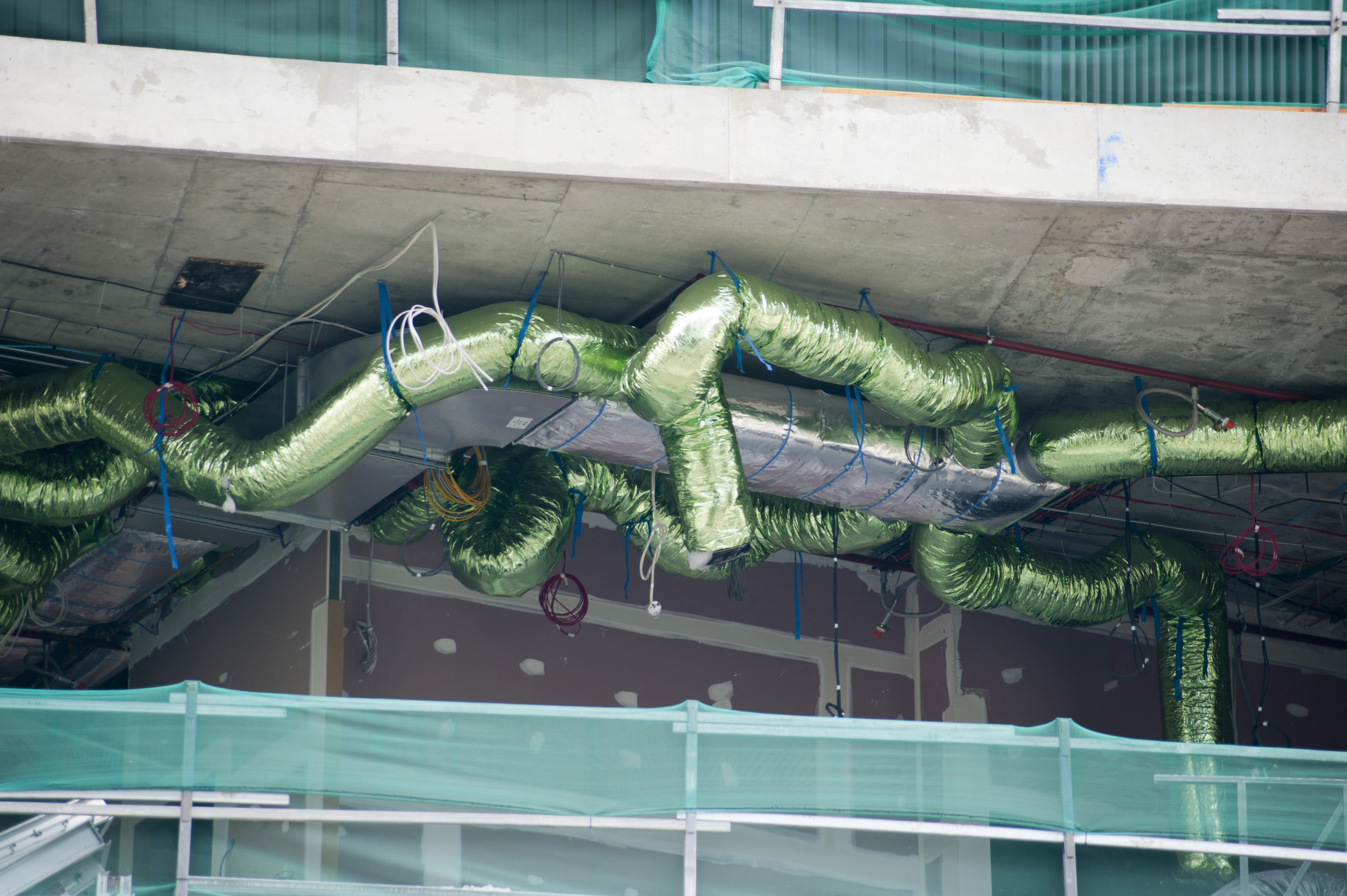Installing Green Air Conditioning Duct Work of a Commerical Building