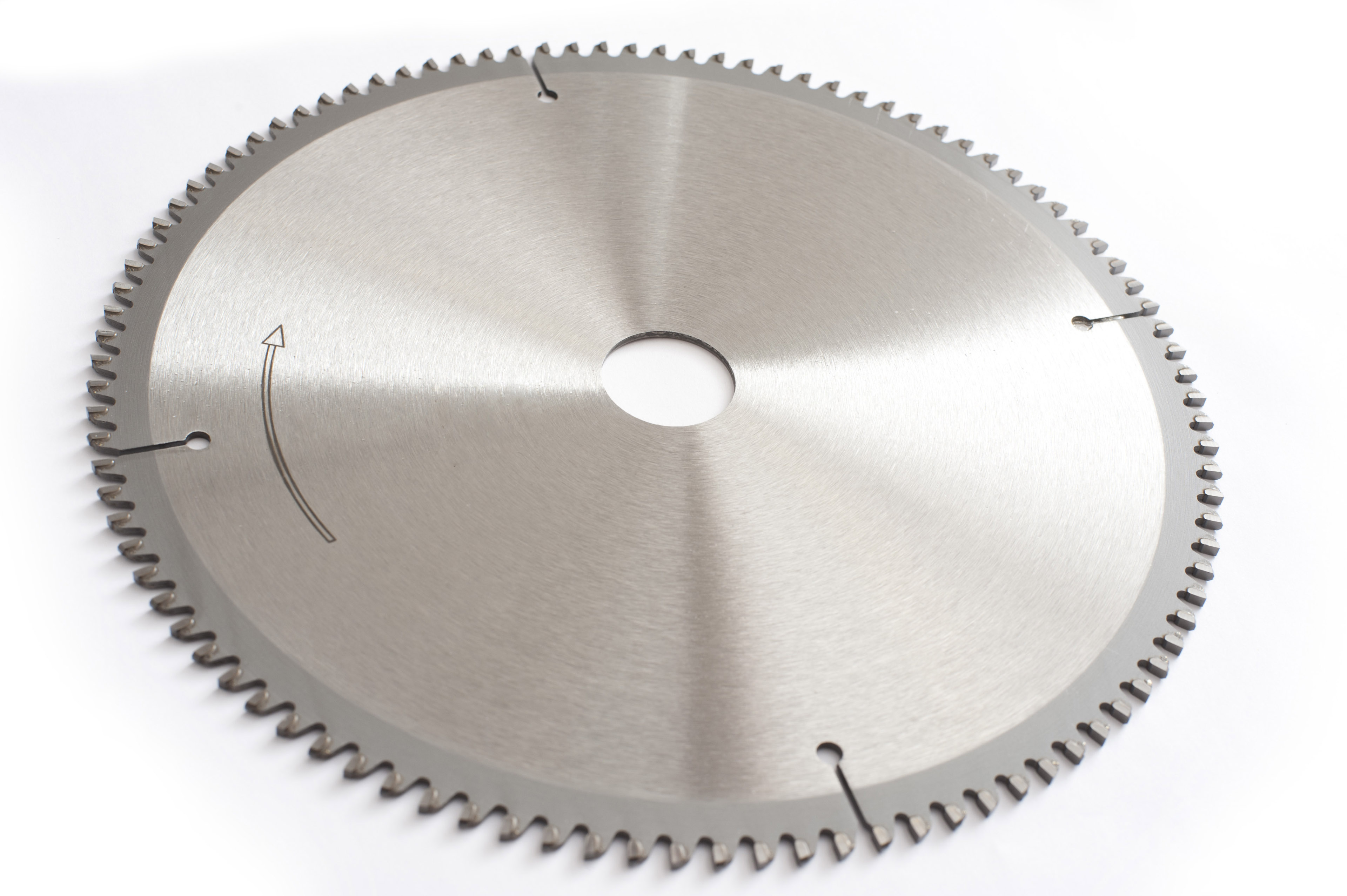 A brand new metal circular saw blade with sharp teeth isolated on a white background with copy space.