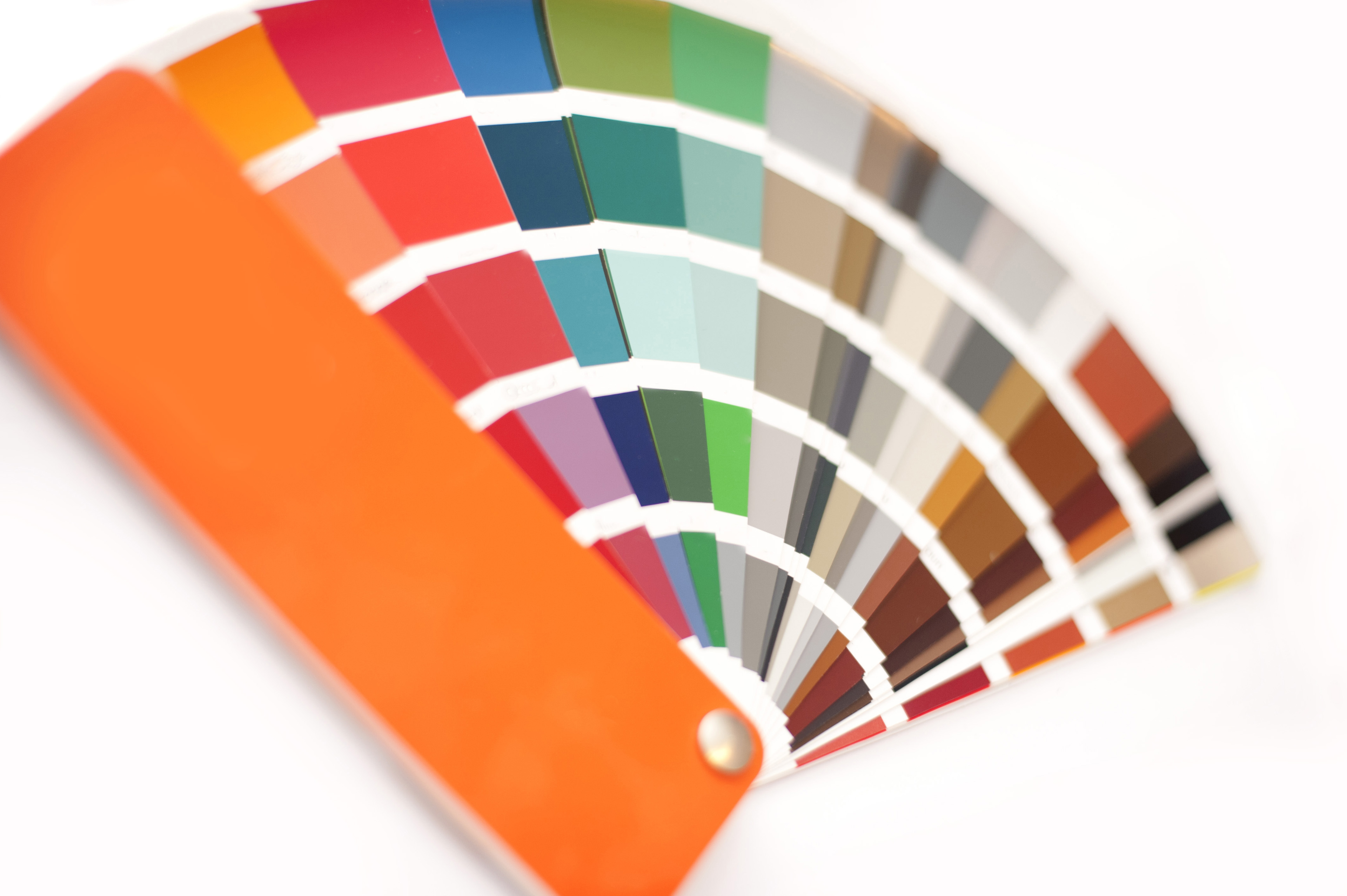 Color picker for interior decorating with swatches in the colors of the spectrum fanned out on a white background