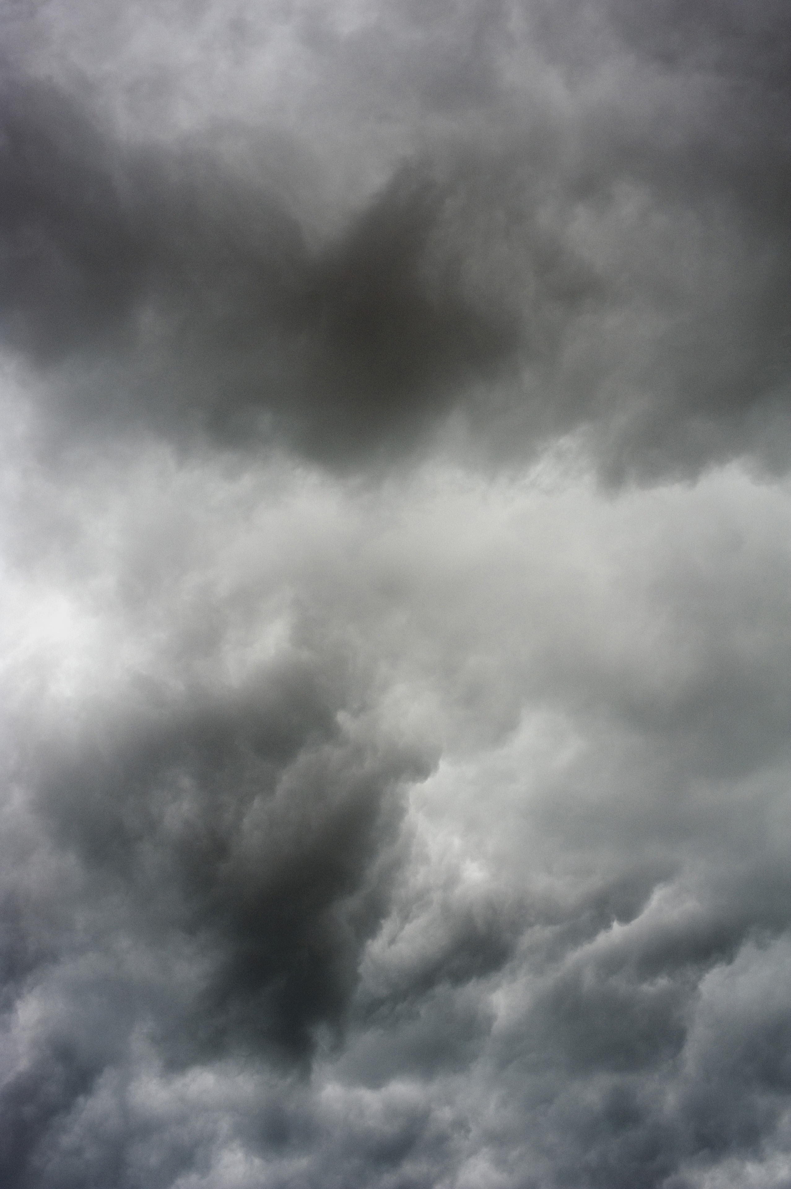 Overcast gray sky with heavy dark clouds, forecasting stormy weather