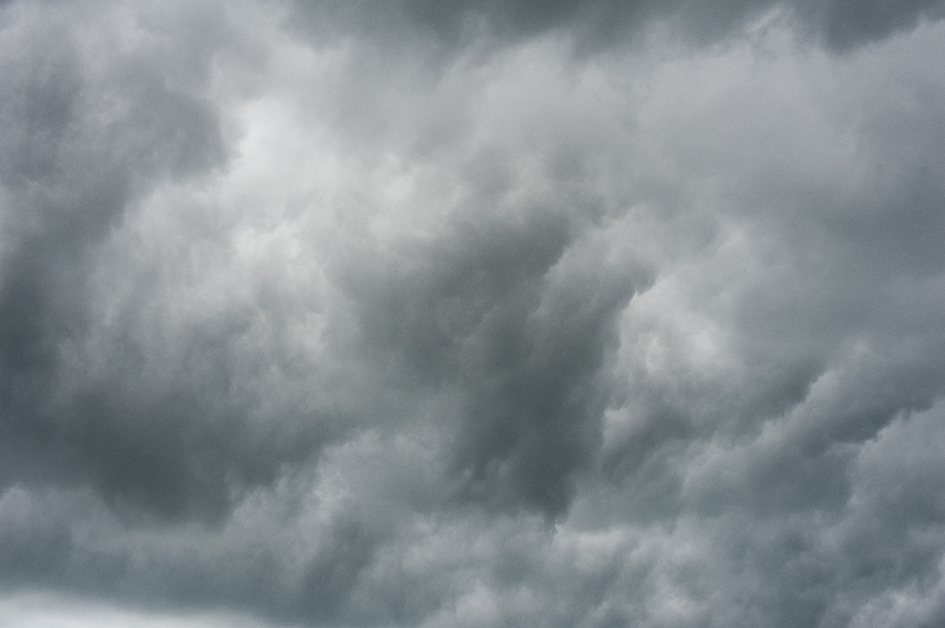 Full frame nature background of a stormy sky with ominous grey clouds for weather themed concepts
