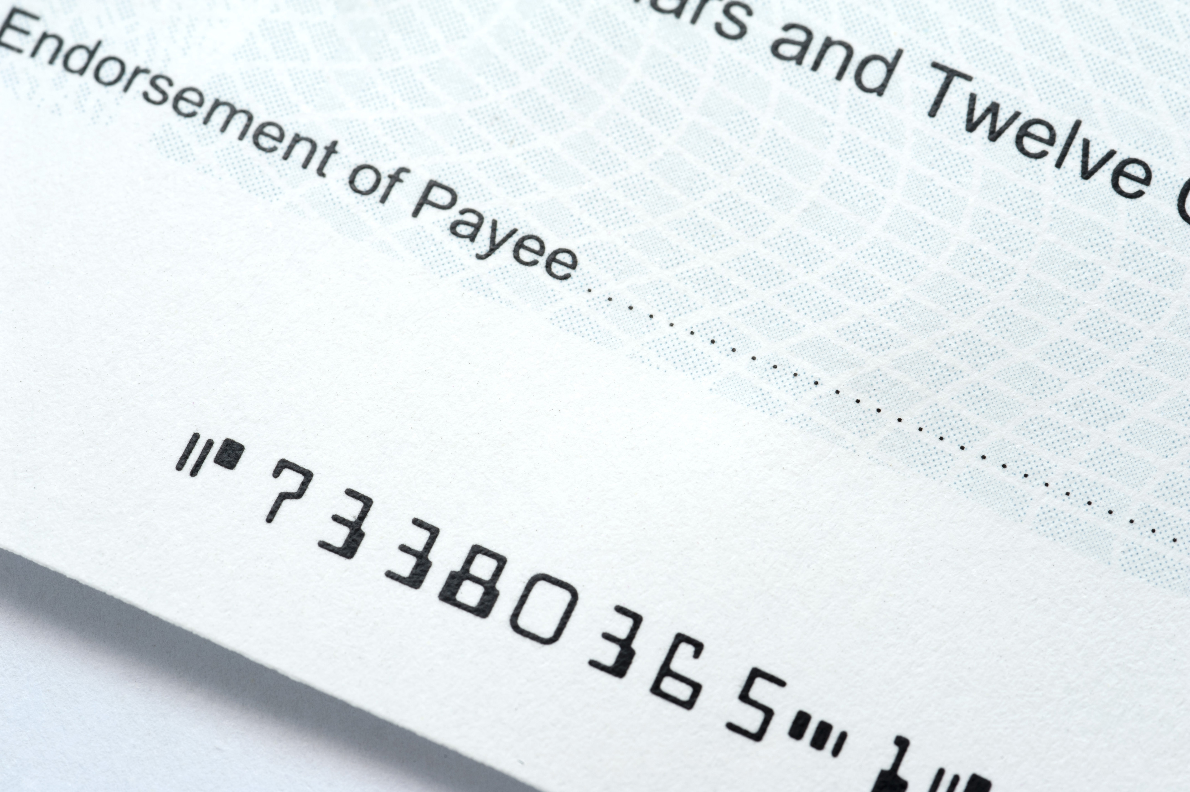 Close up of a bank cheque with blank Payee details in a payment and purchase concept