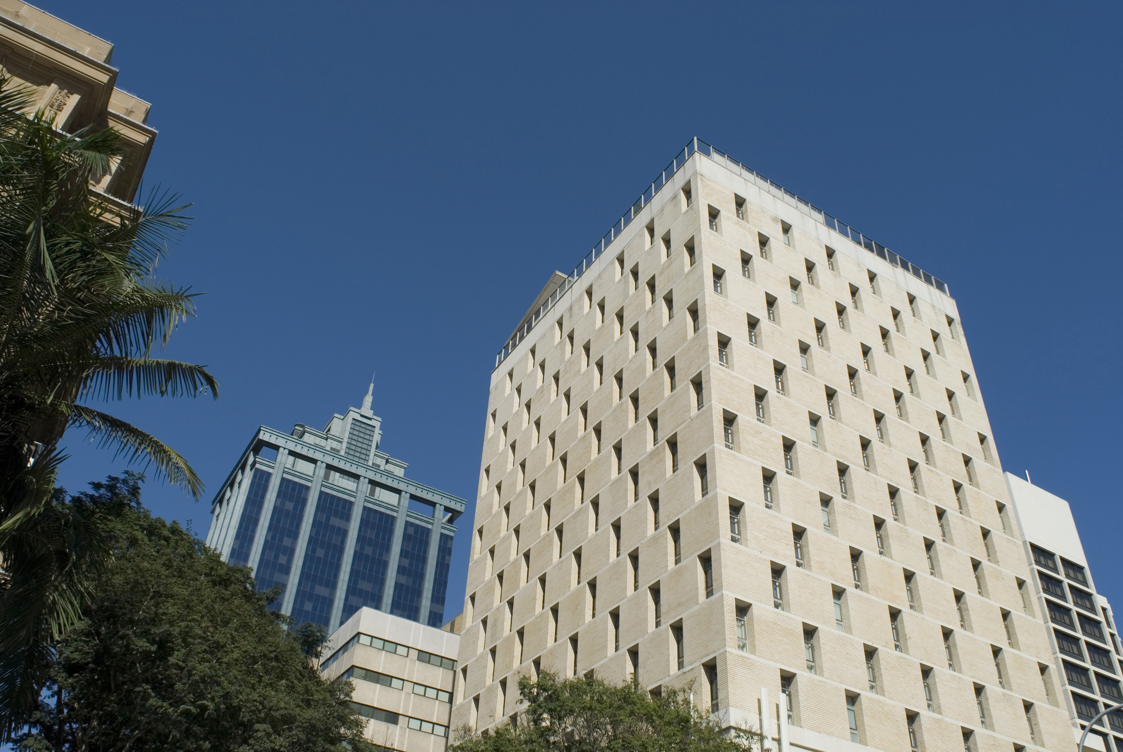 Exterior View of Architectural High City Offices on Blue Gray Sky Background