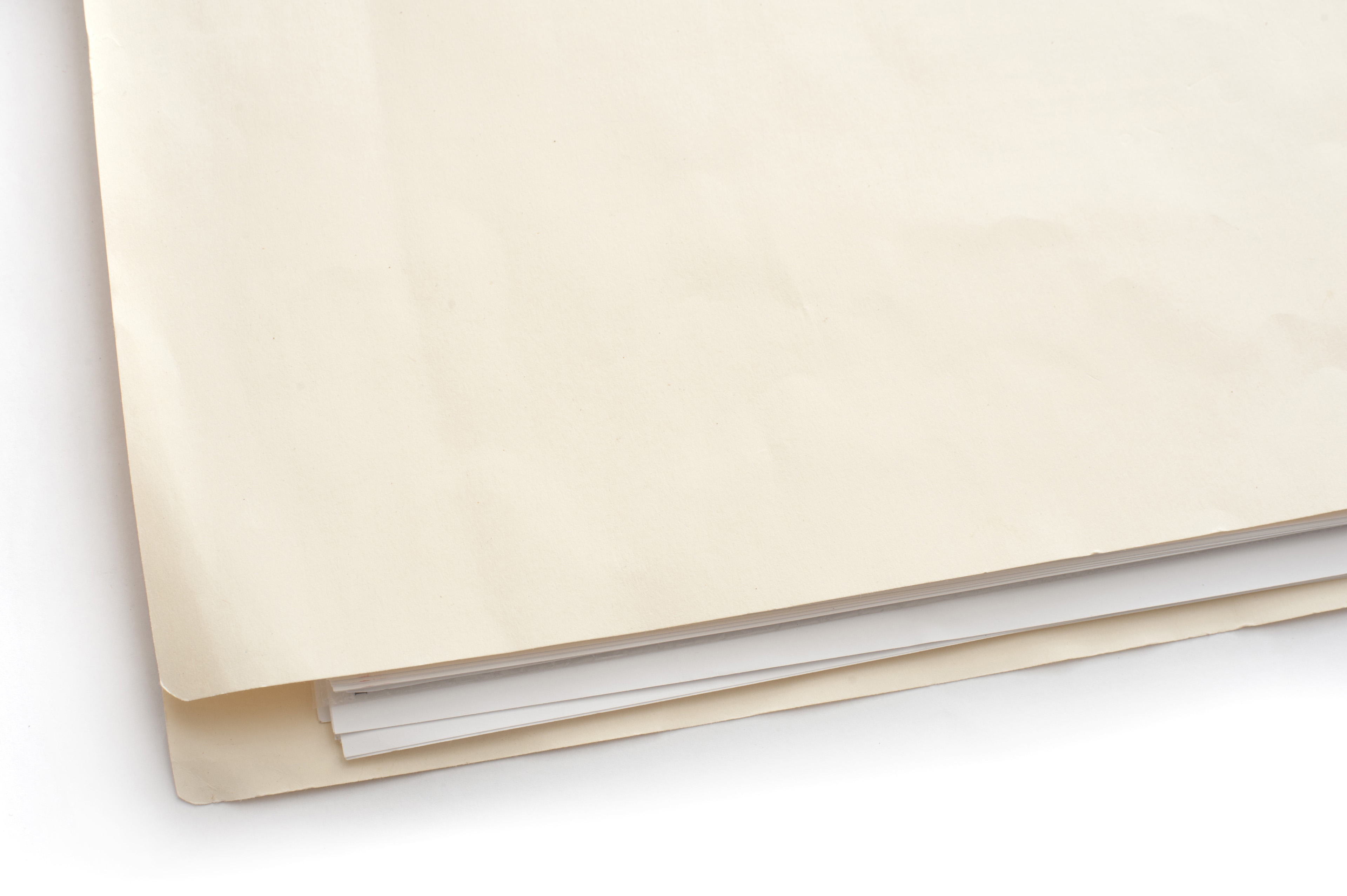 Close up Light Brown Folder with Documents Inside on White Table, Emphasizing Copy Space for Texts