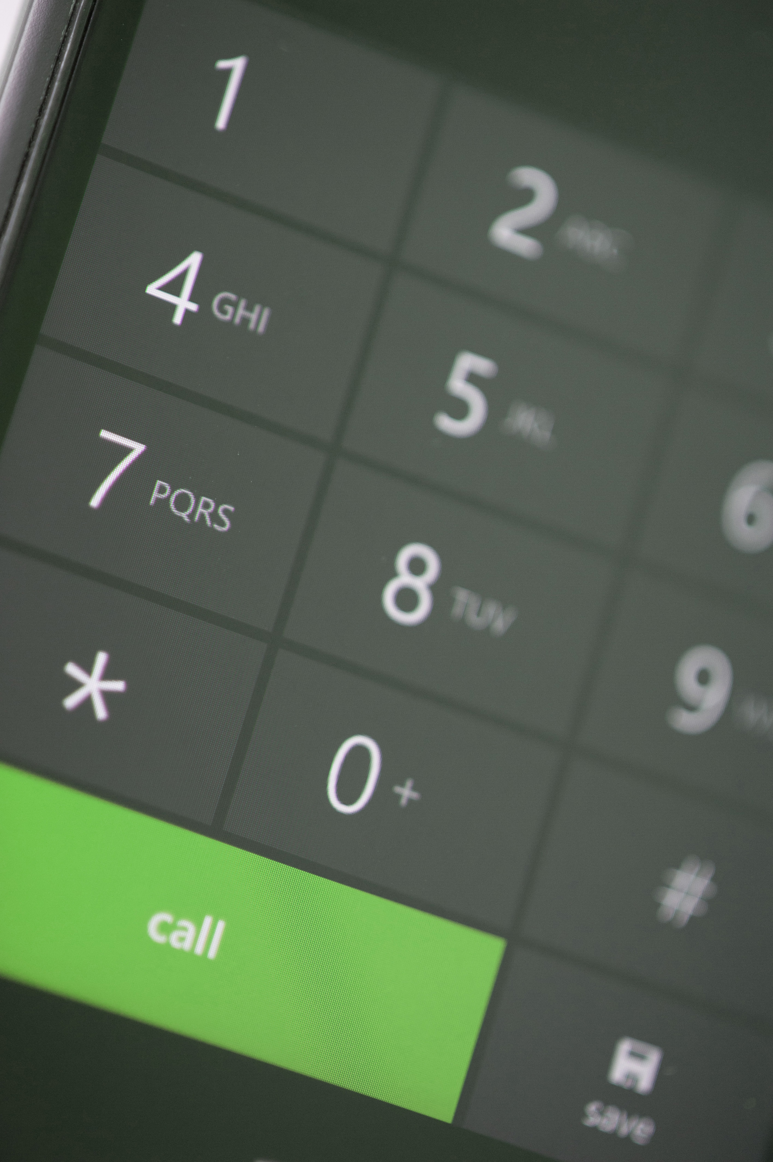Close up Green Call Button on a Modern Touch Screen Mobile Phone