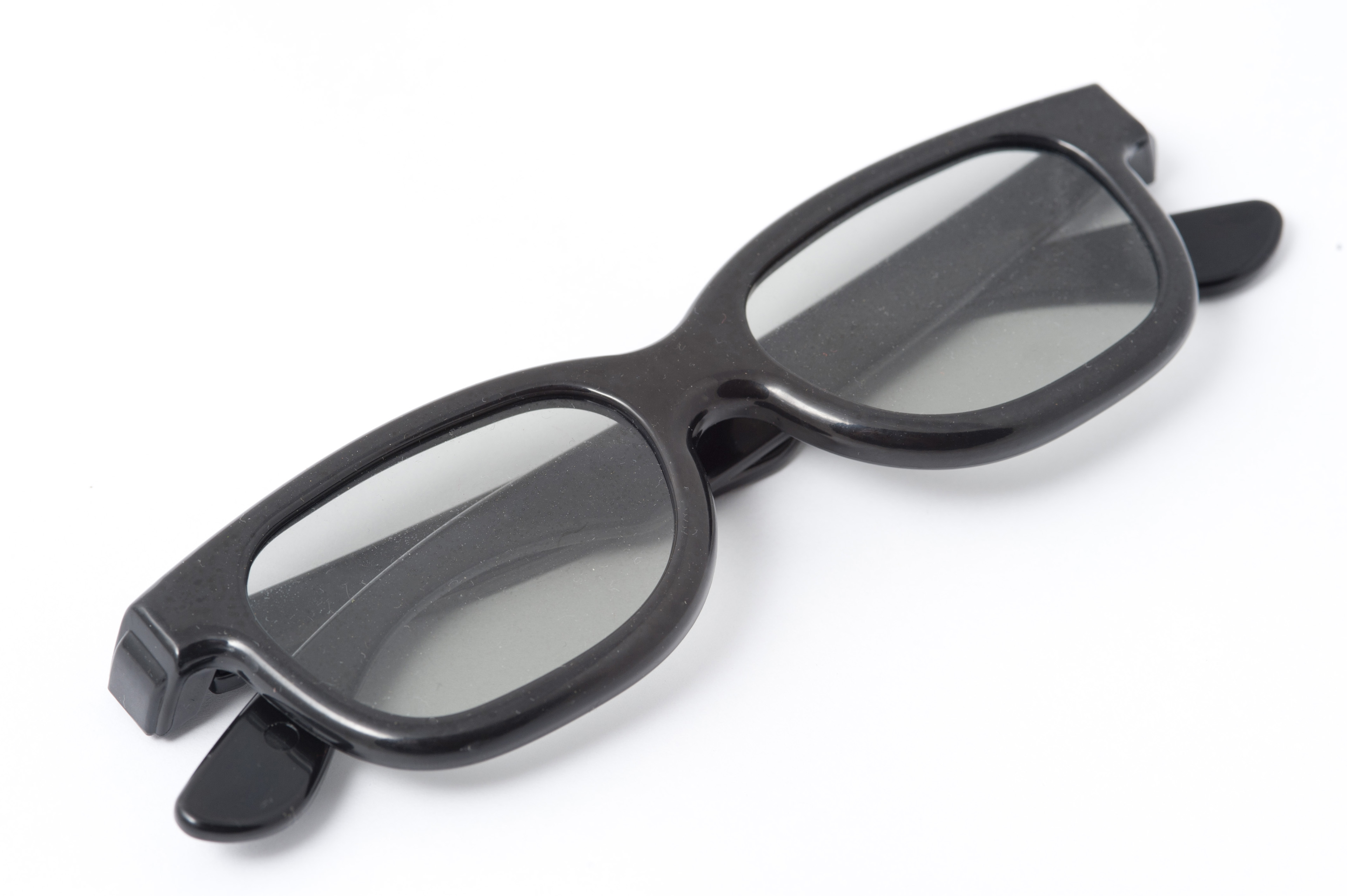 A pair of polarizing 3D movie spectacles on a white background