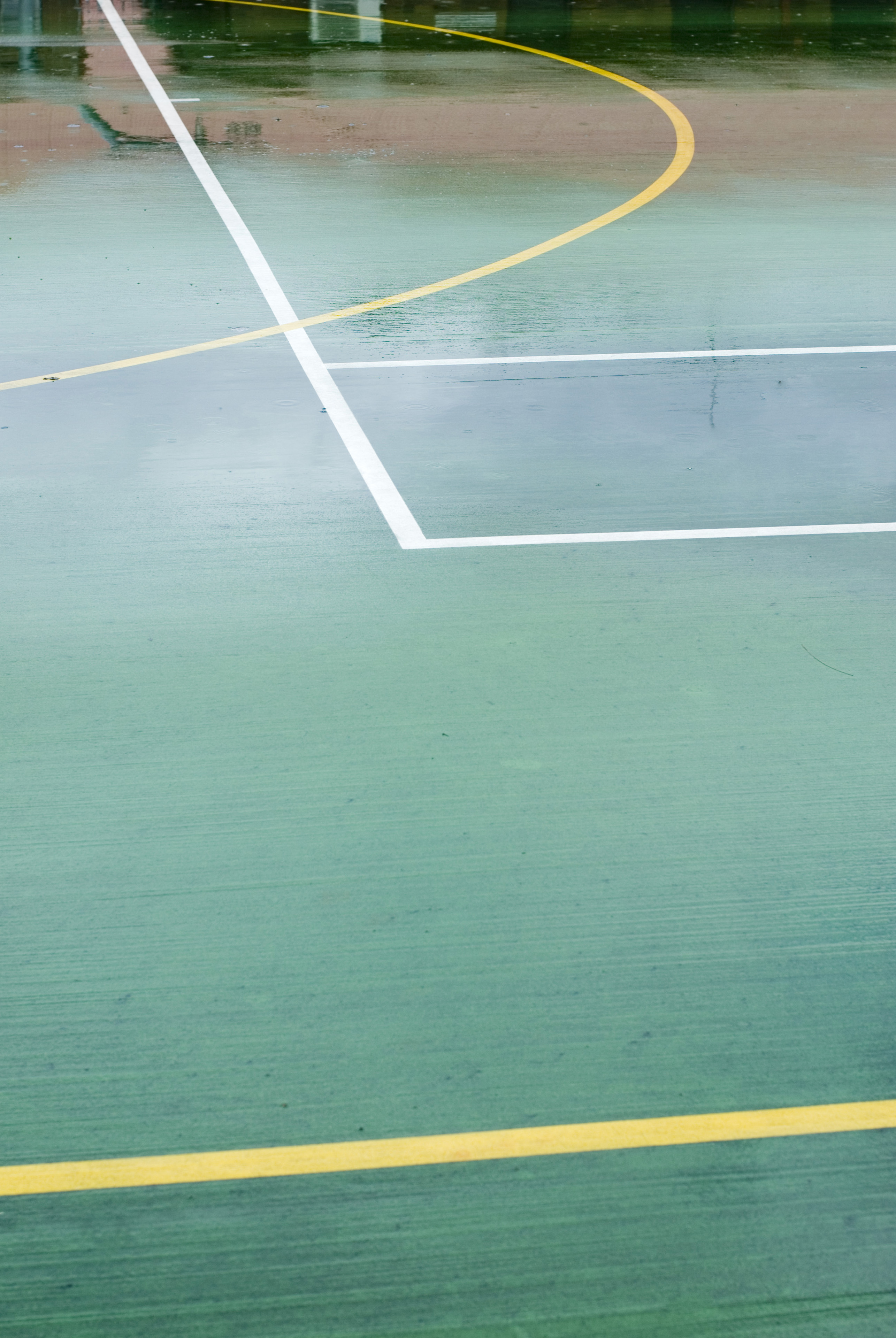 The corner of a tennis or soccer hard court painted on the ground
