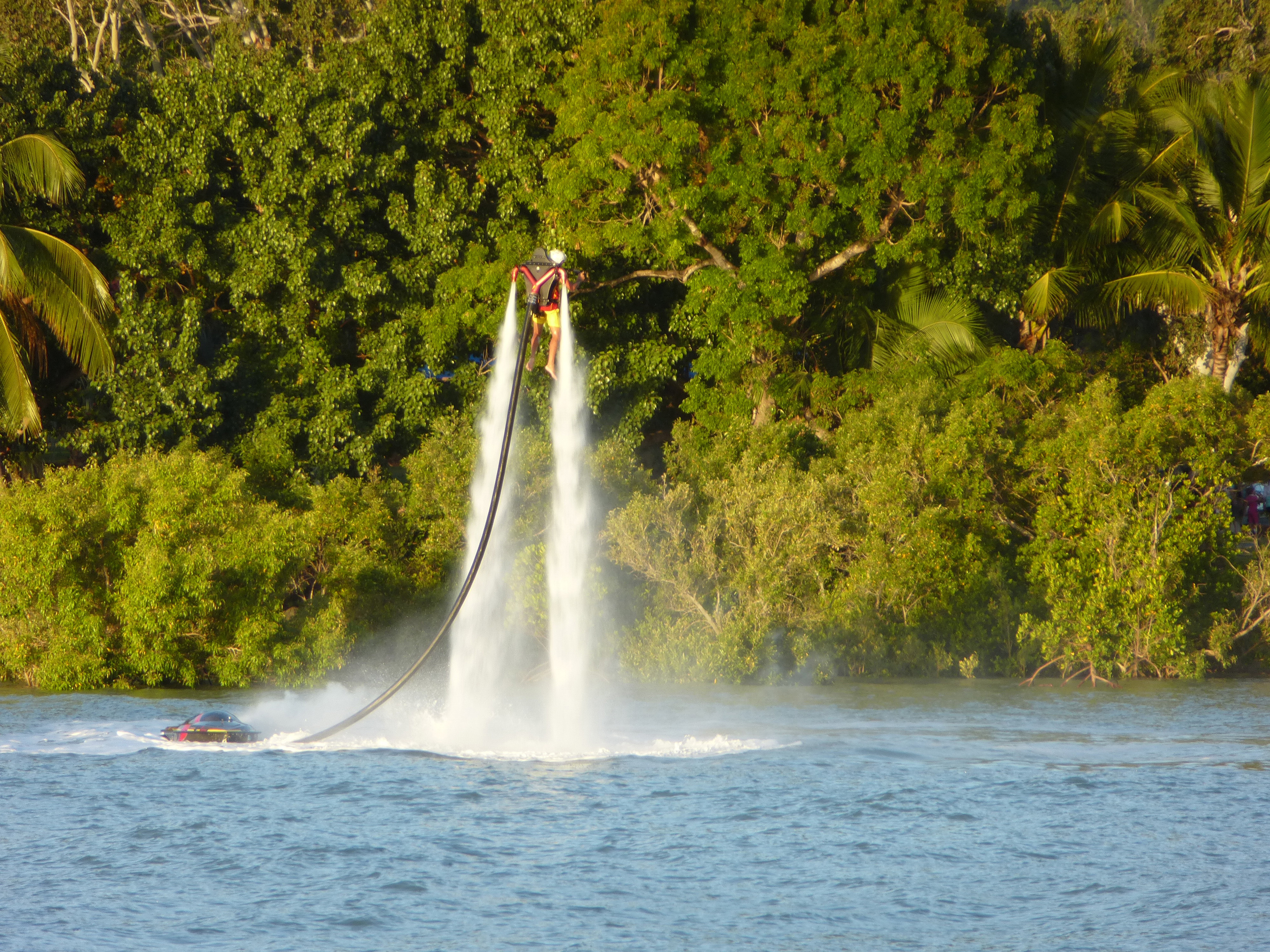 Jet Boarding or Fly Boarding, hovering in the air on a stream of high pressue water from a jetski