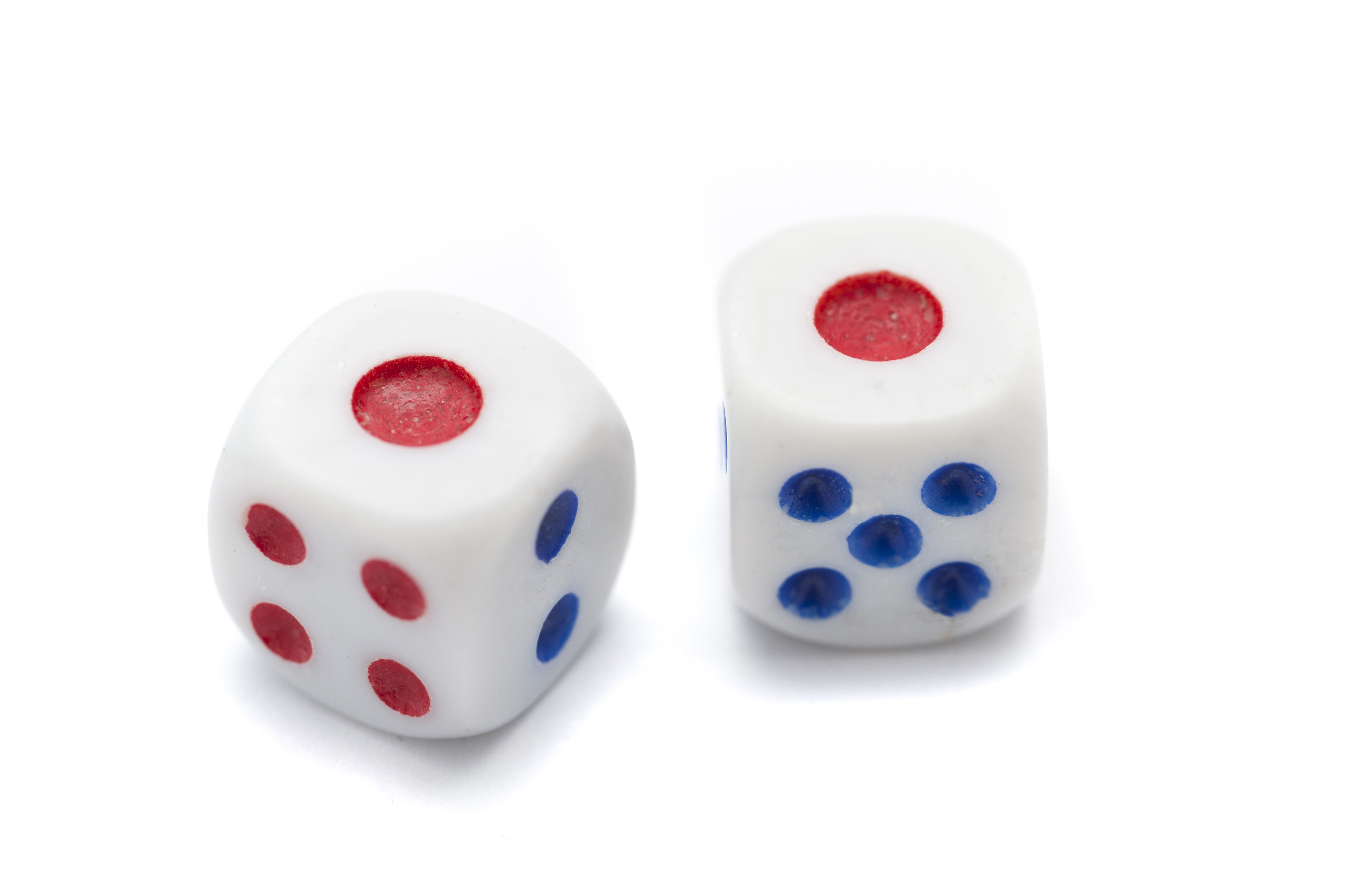 Close up Two Rolling Snake Eyes Dice with Blue and Red Markings, Isolated on White Background