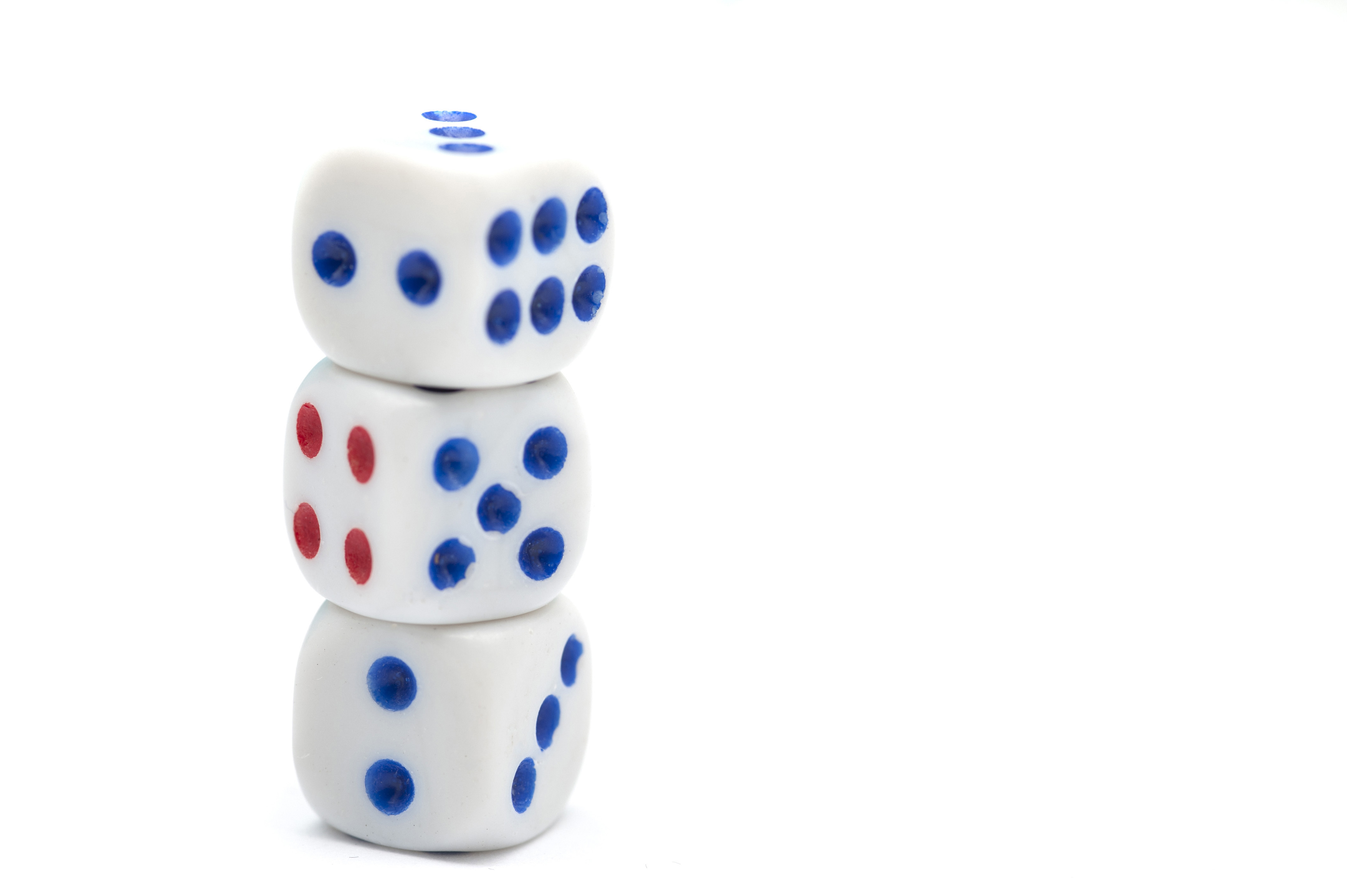 Three Dice with Blue and Red Dots Stacked Vertically on White Background