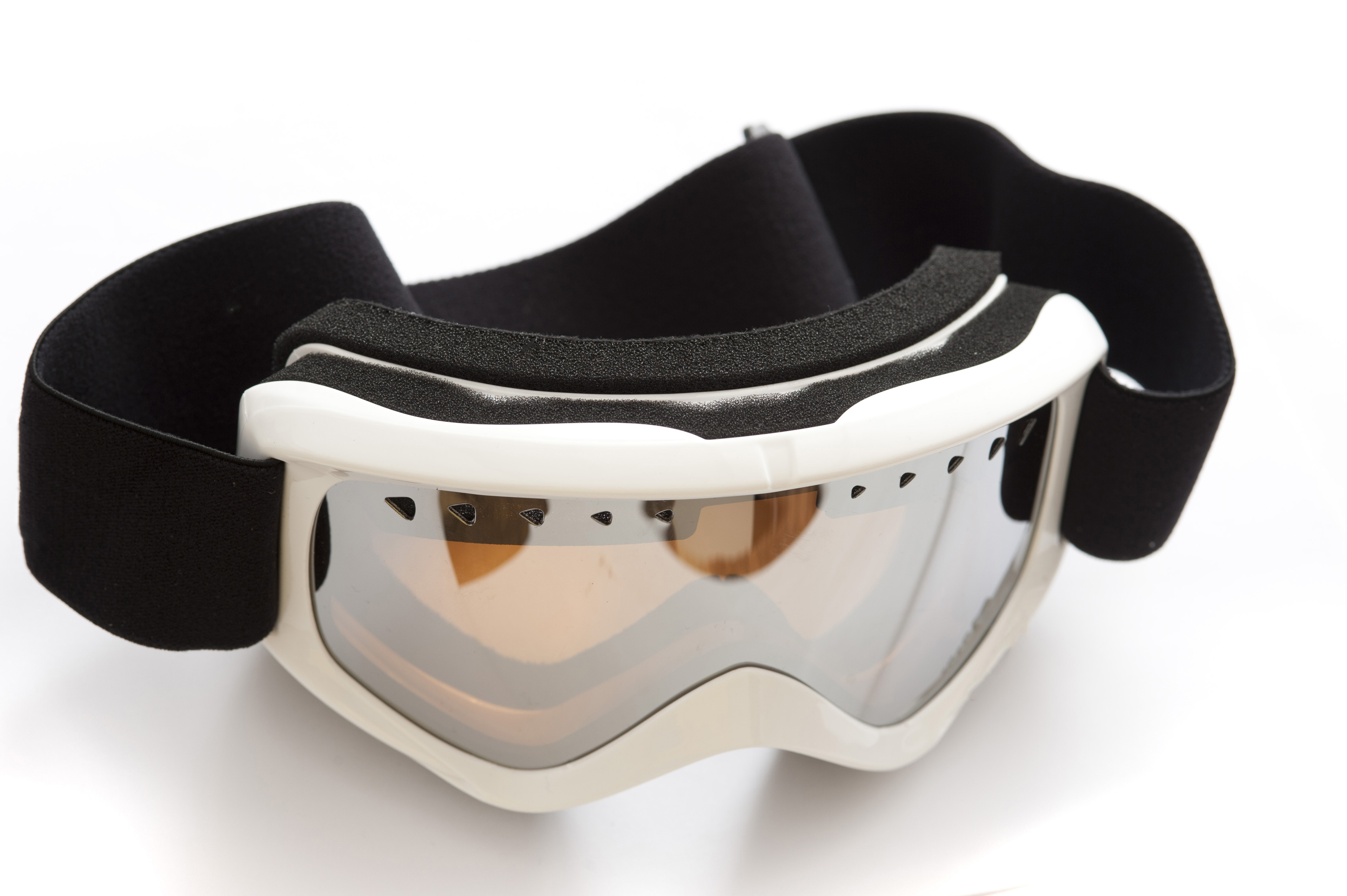 Pair of tinted winter goggles for skiing or snowboarding to protect the eyes from injury and the reflection off the snow