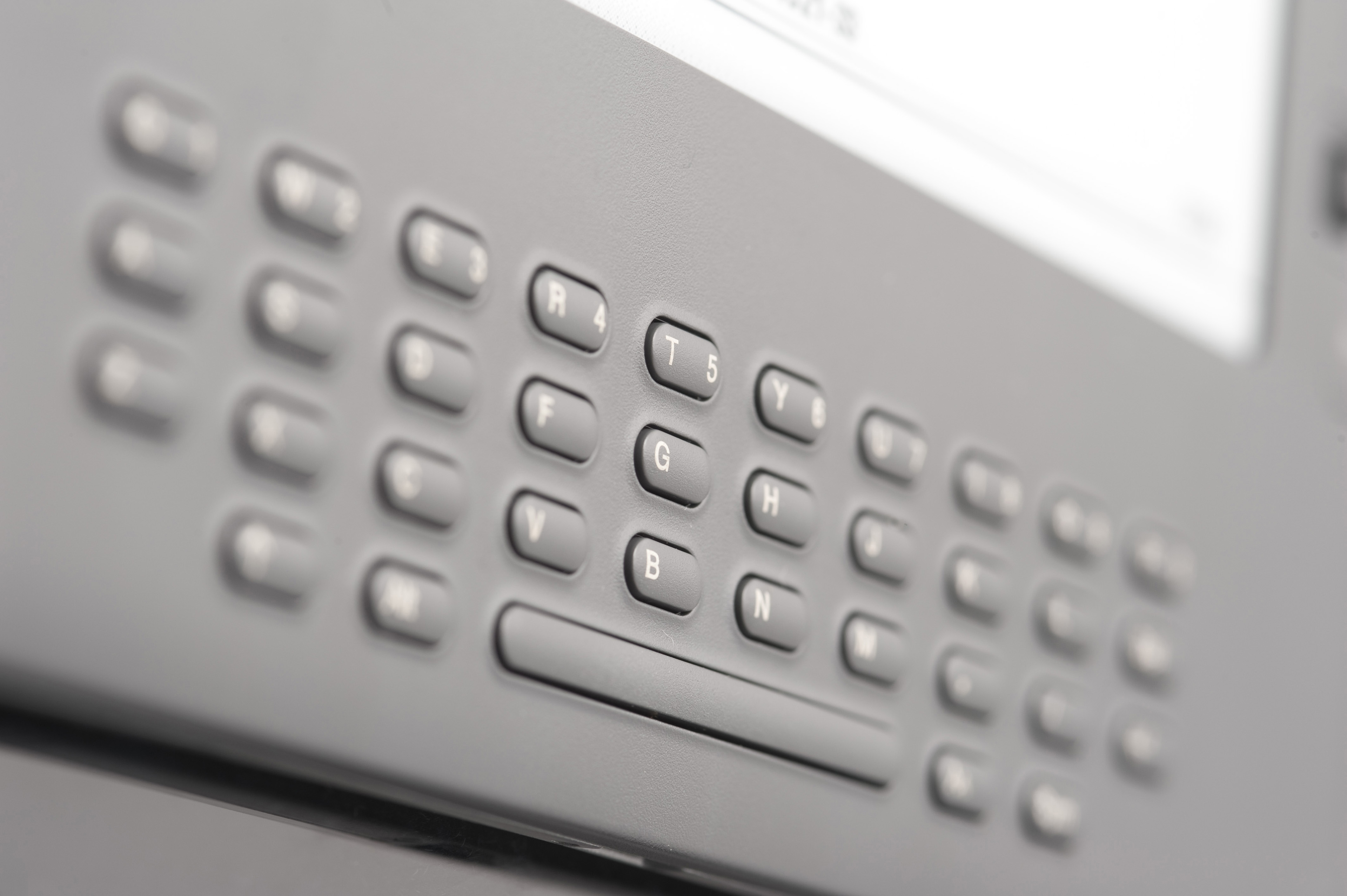 Close Up Detail of Electronic Book Reader Keyboard, Selective Focus on Center Keys