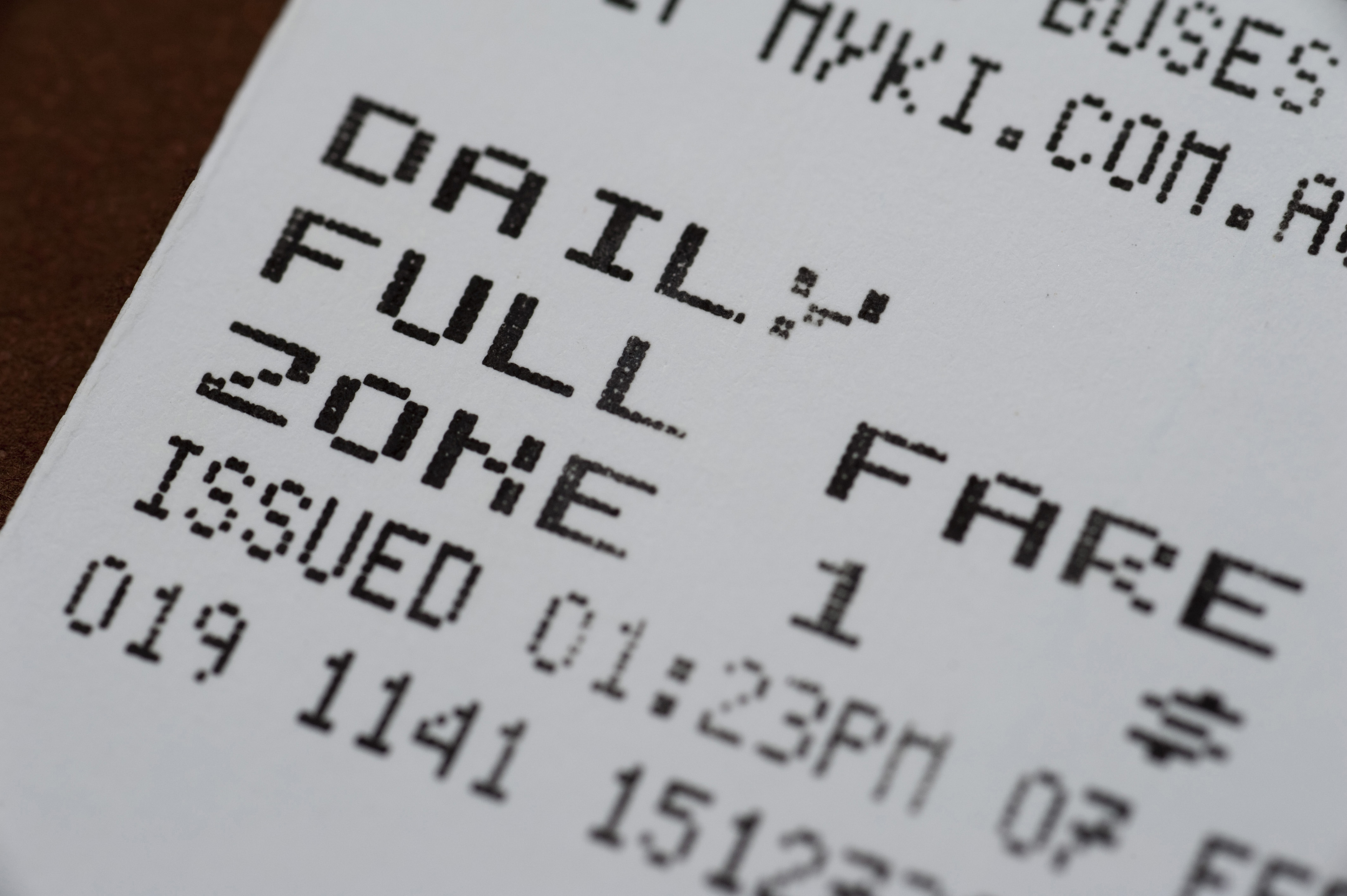 Close Up Detail of Bus Ticket with Full Fare Payment in Zone One