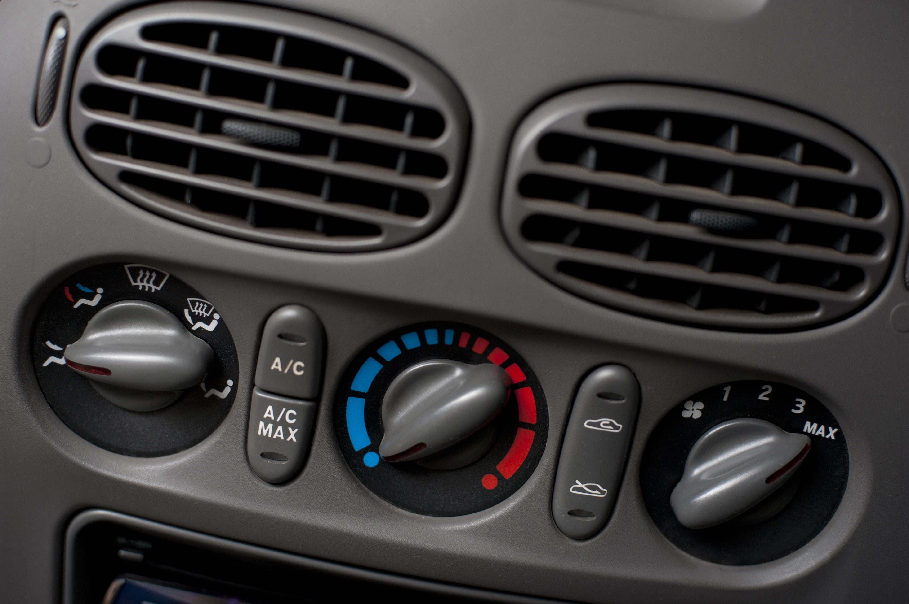 Close Up of Vehicle Dashboard Showing Detail of Climate Controls and Vents