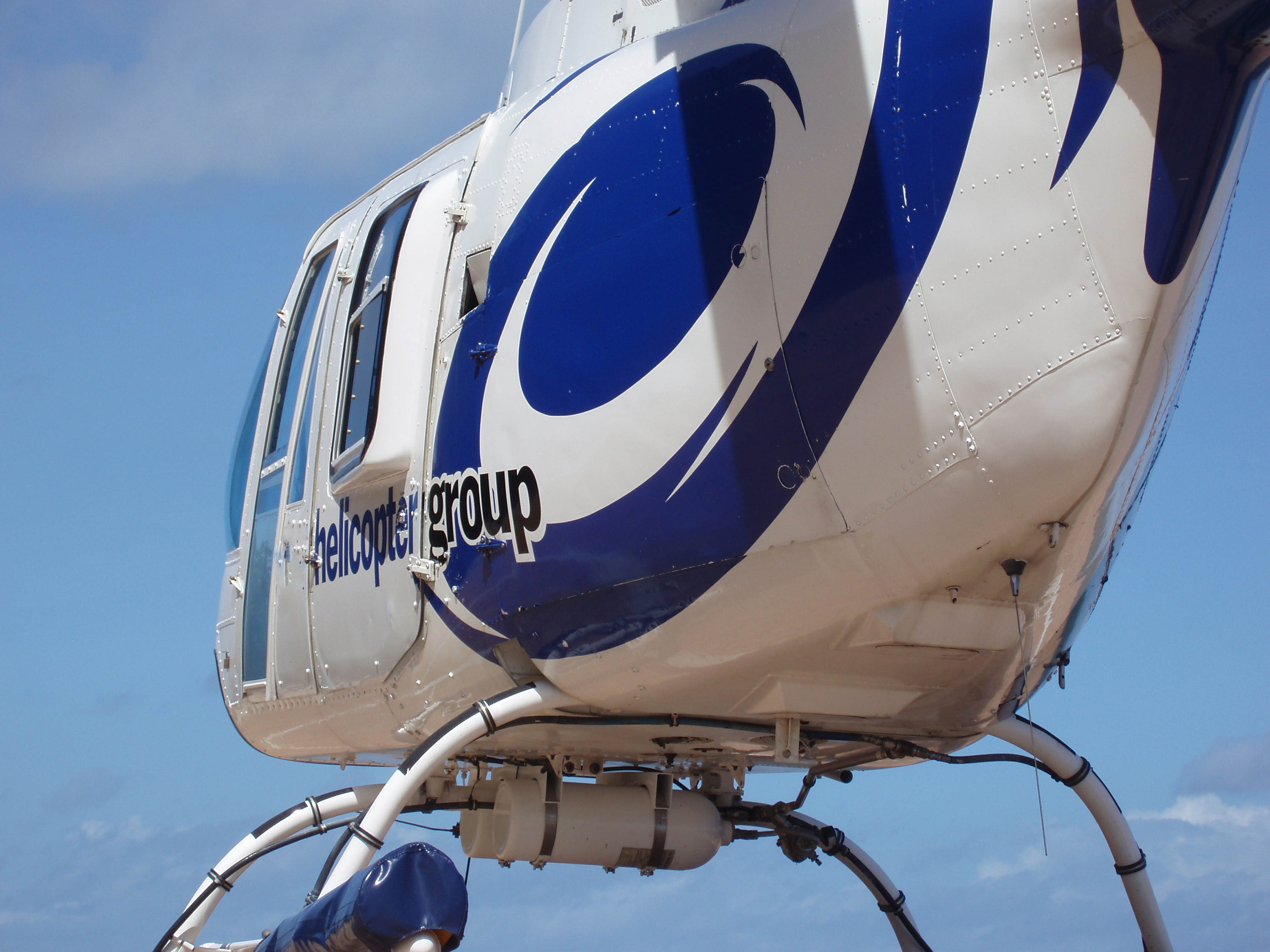Close Up of Blue and White Helicopter Shot from Behind and Below