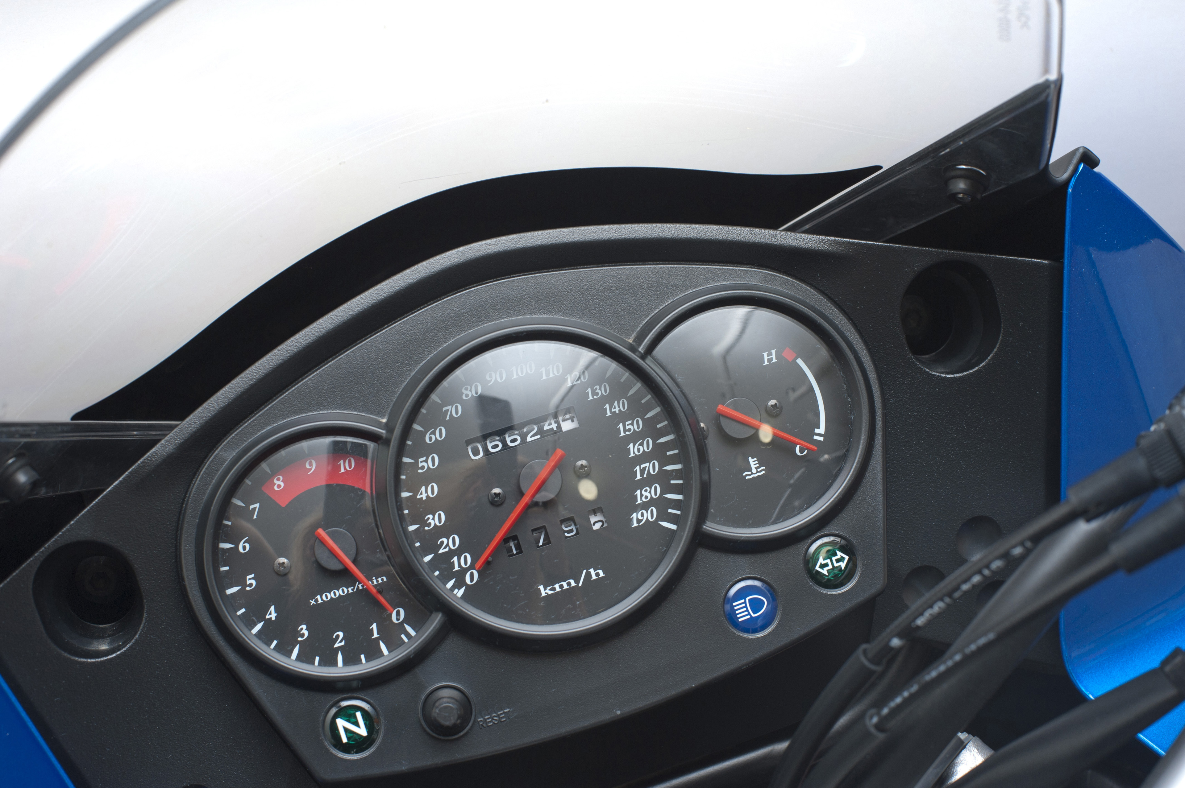 Close Up of Motorcycle Instrument Dash Panel Showing Speedometer, Tachometer, and Fuel Gauge