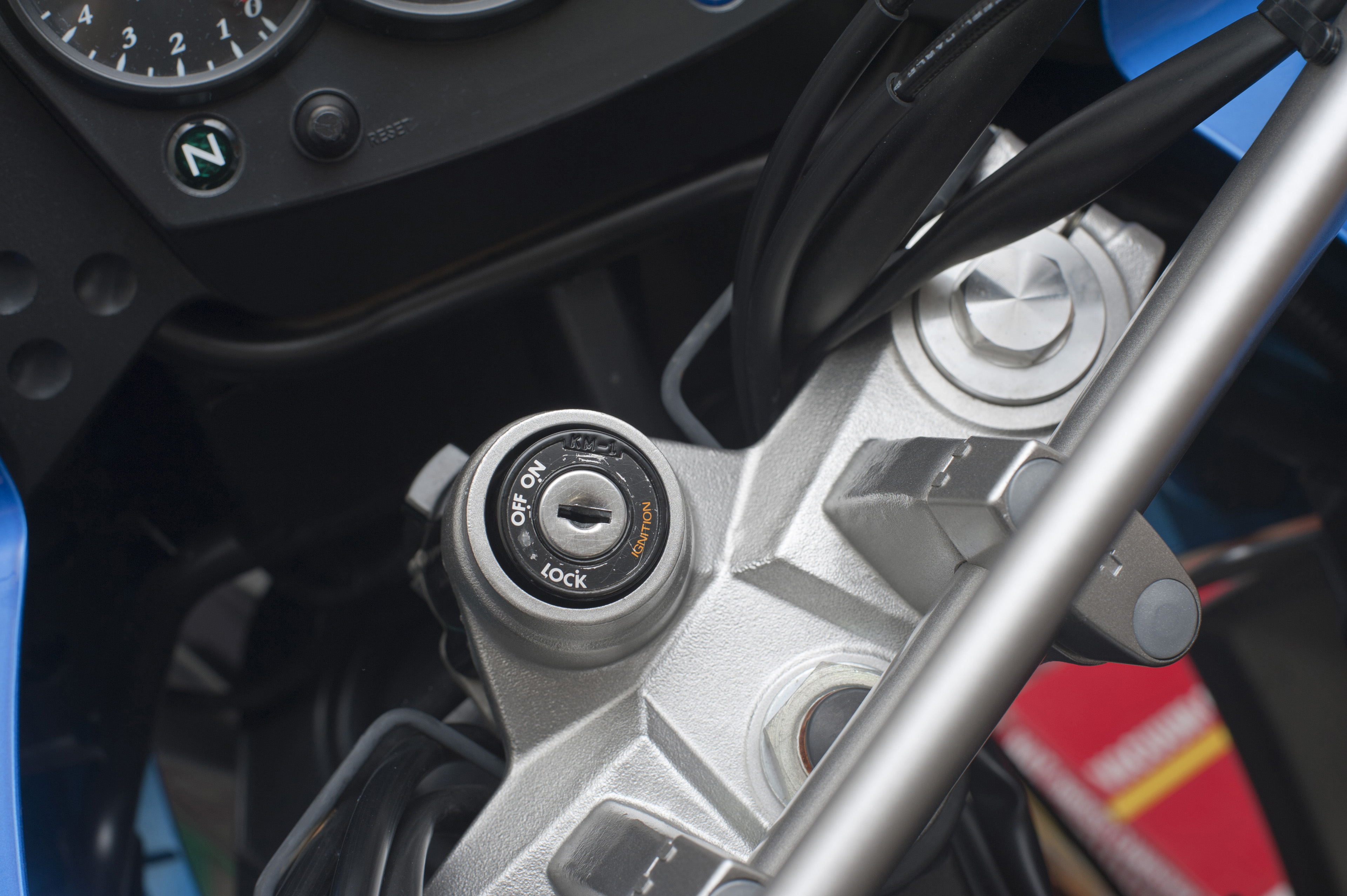 Close Up of Locking Ignition Switch in Off Position on Motorcycle Console