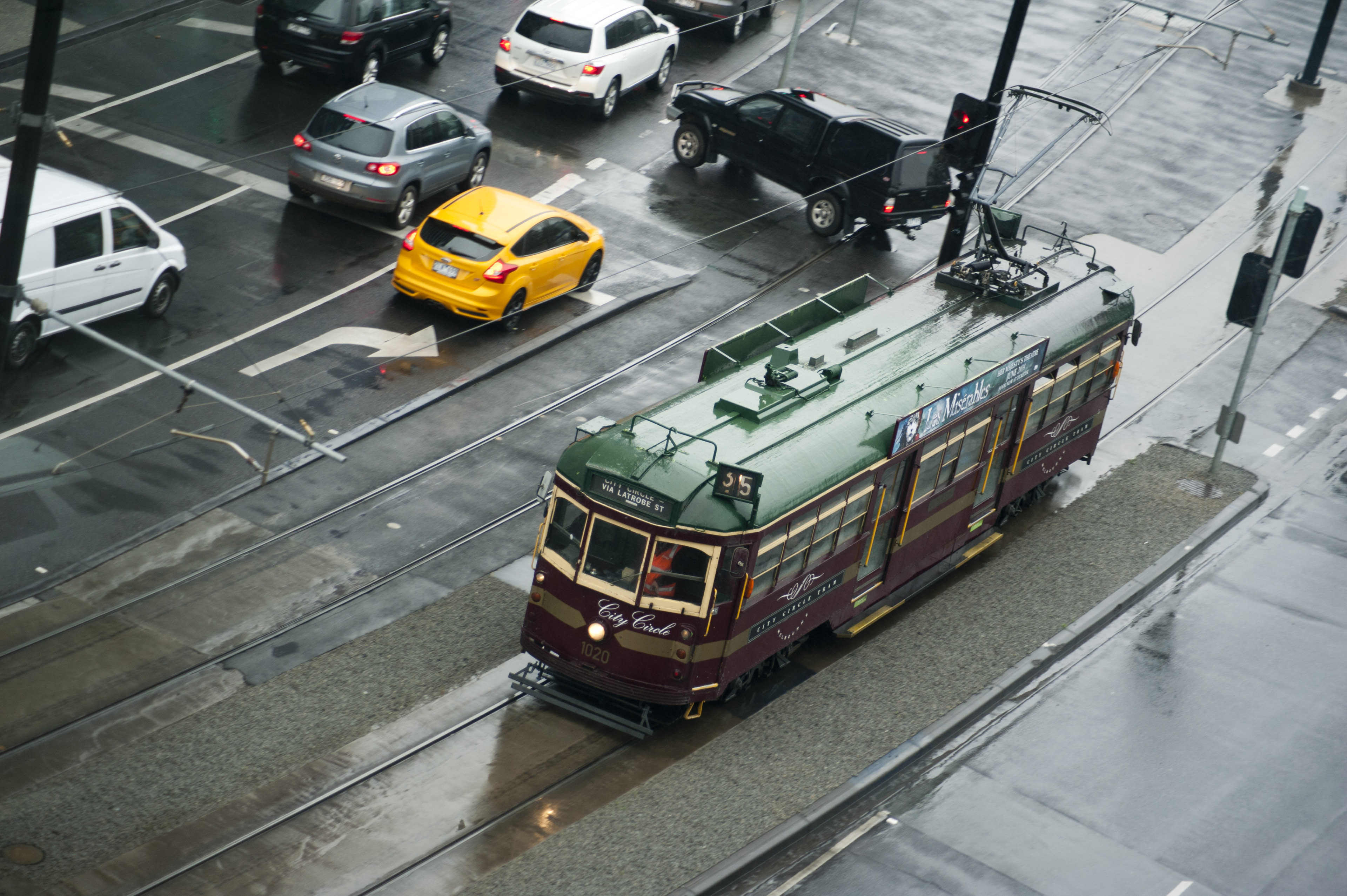 Aerial view of street tram and traffic on rainy day
