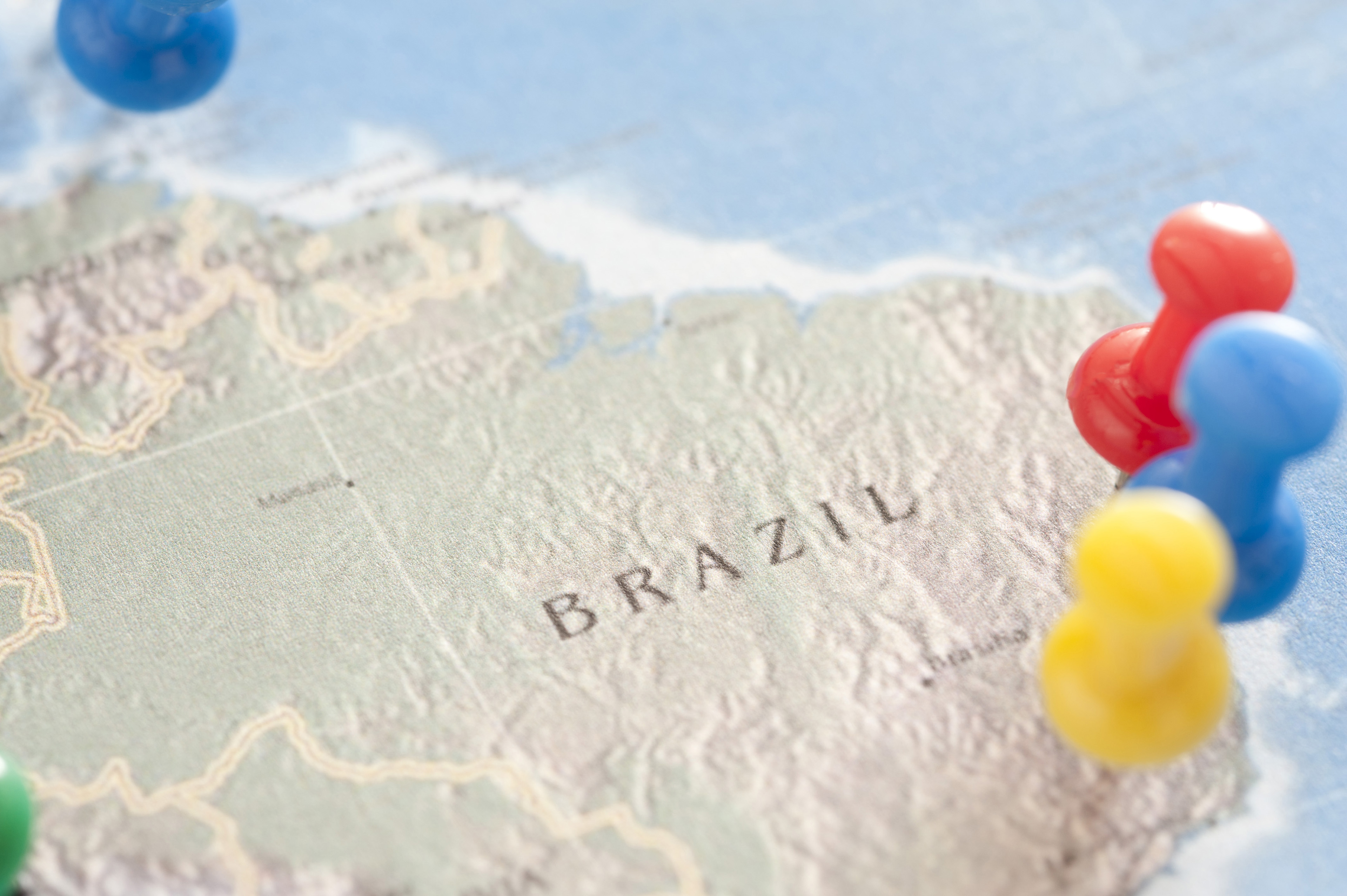 Close Up of Colorful Tacks Pinned into Various Locations on Map of Brazil, Travel Themed Planning