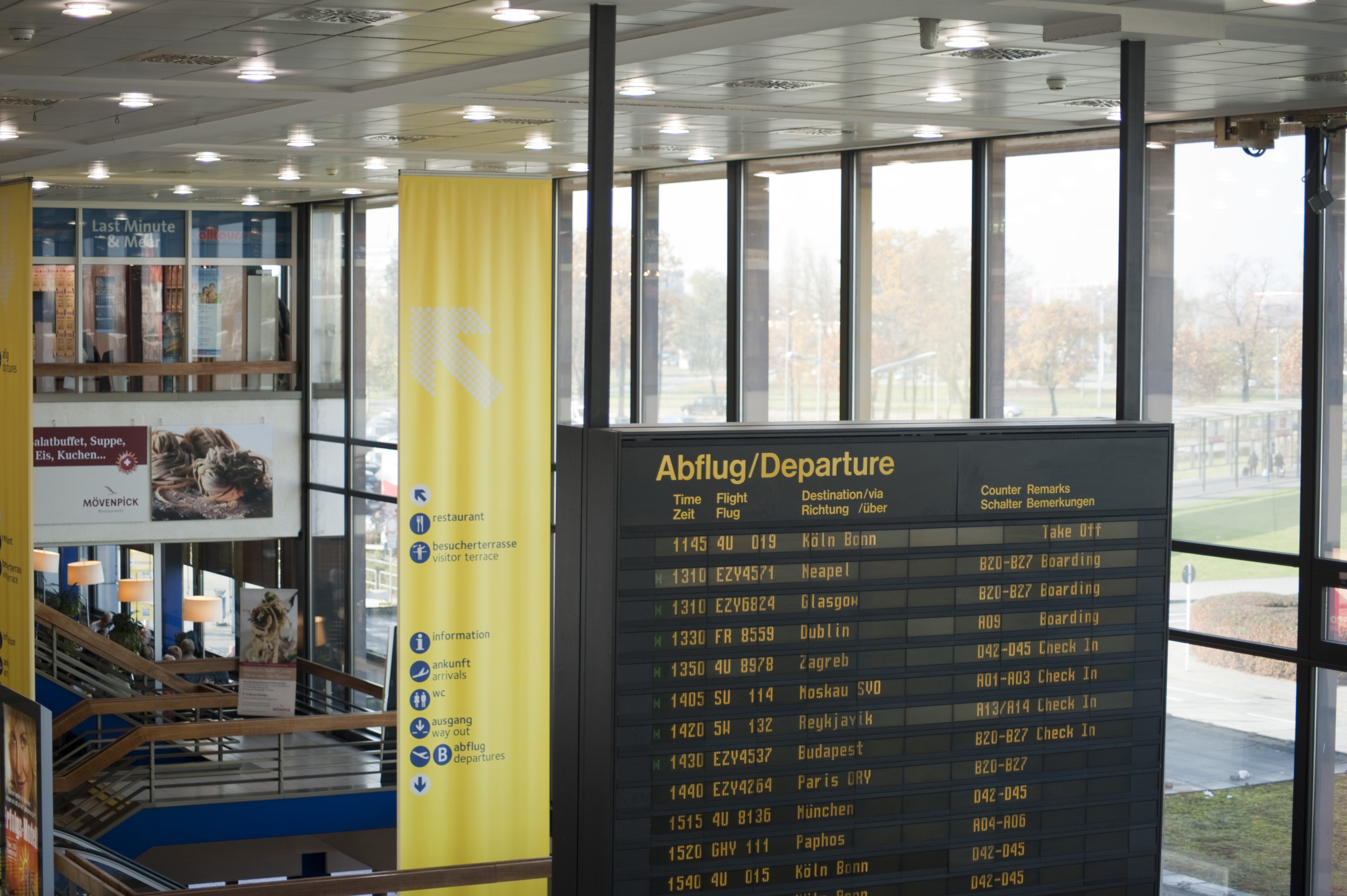 Departure Board at the Second Floor of Modern Architectural Airport Building.