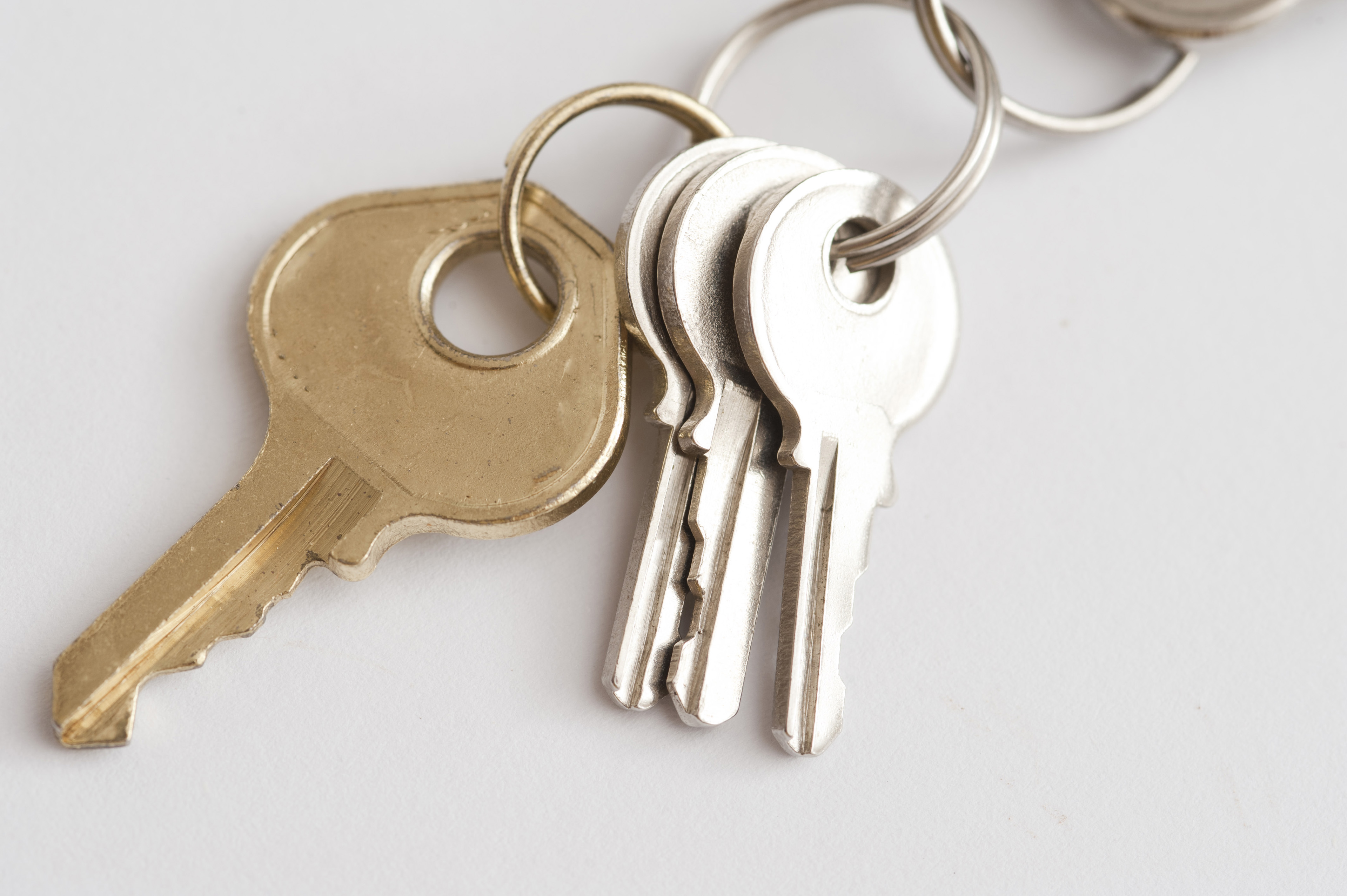 Bunch of luggage keys on a ring to secure baggage on a trip from opportunistic theft by baggage handlers and in hotels