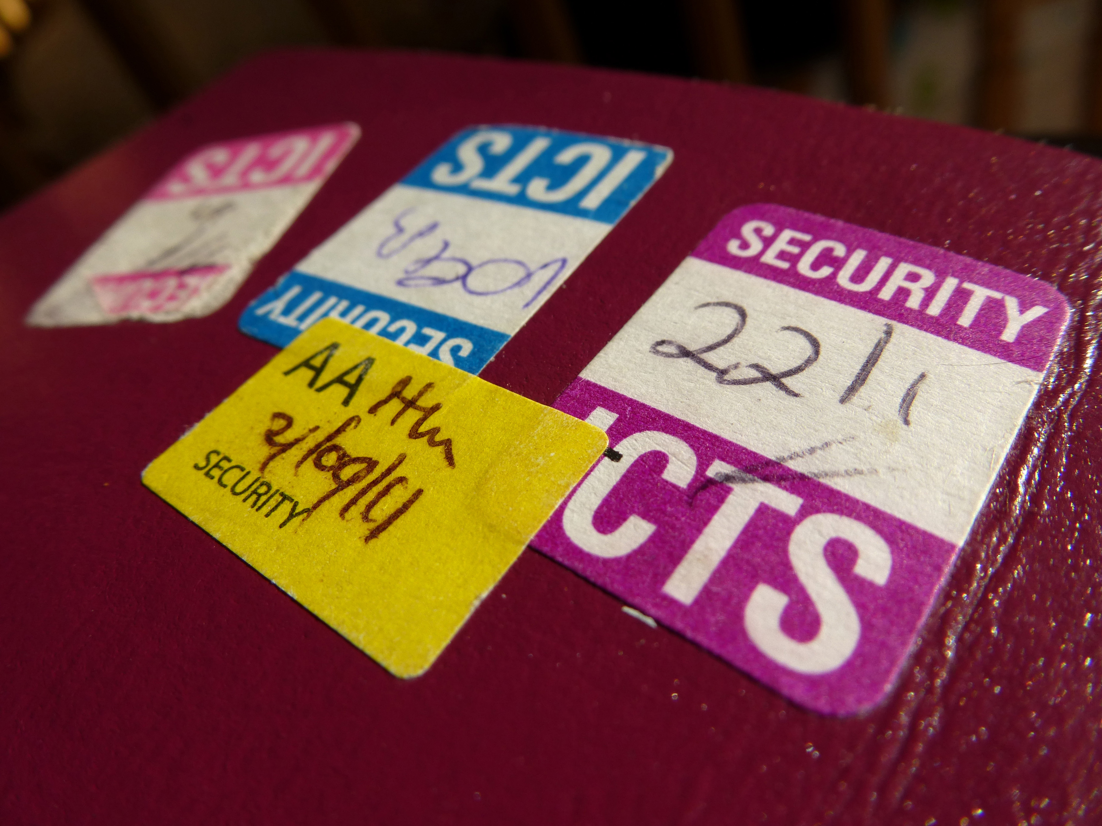 Security stickers aded to a passport to confirm the passenger has been checked by security