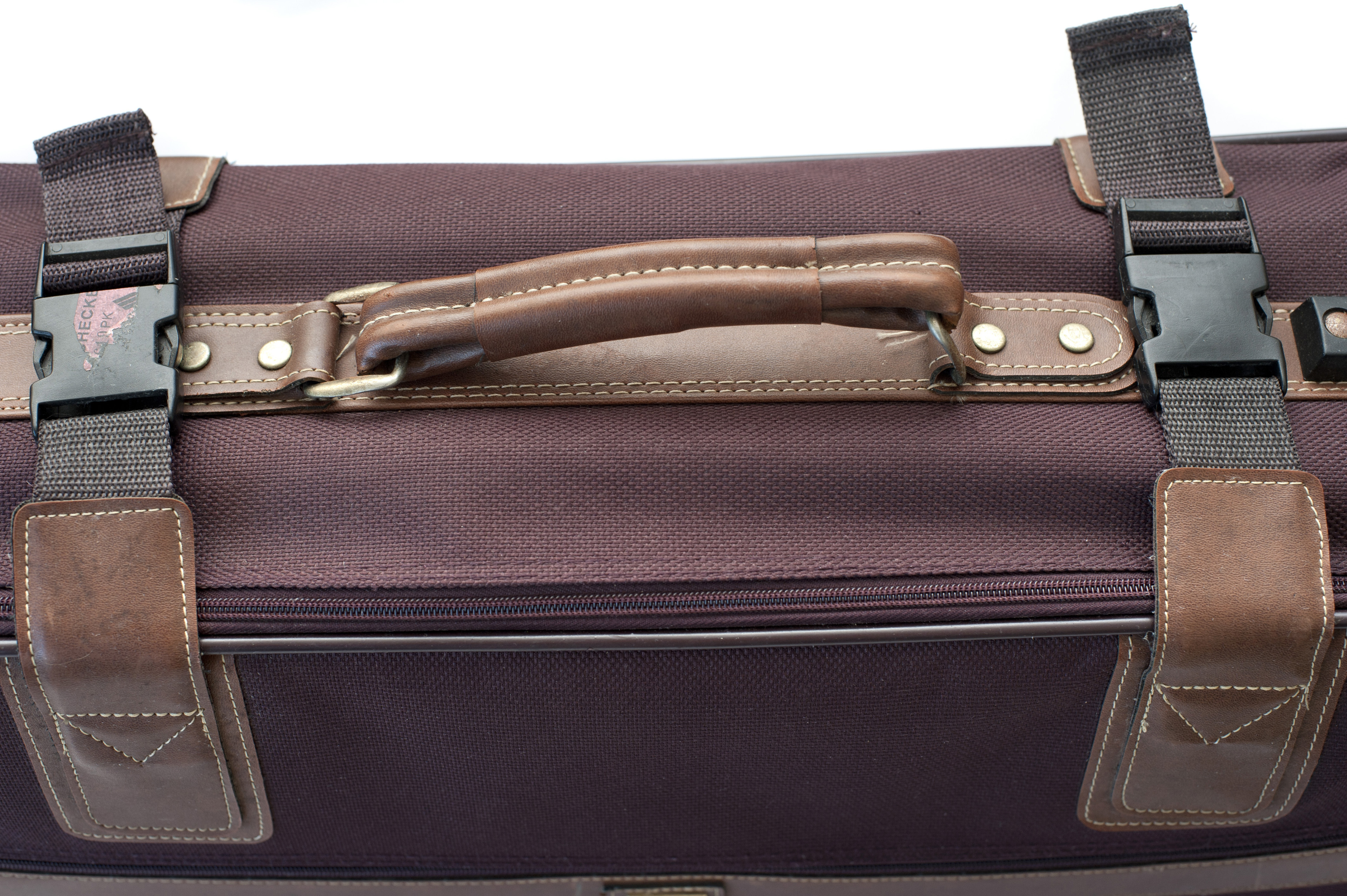 Close Up of Handle on Burgundy Cloth Suitcase Secured with Clips