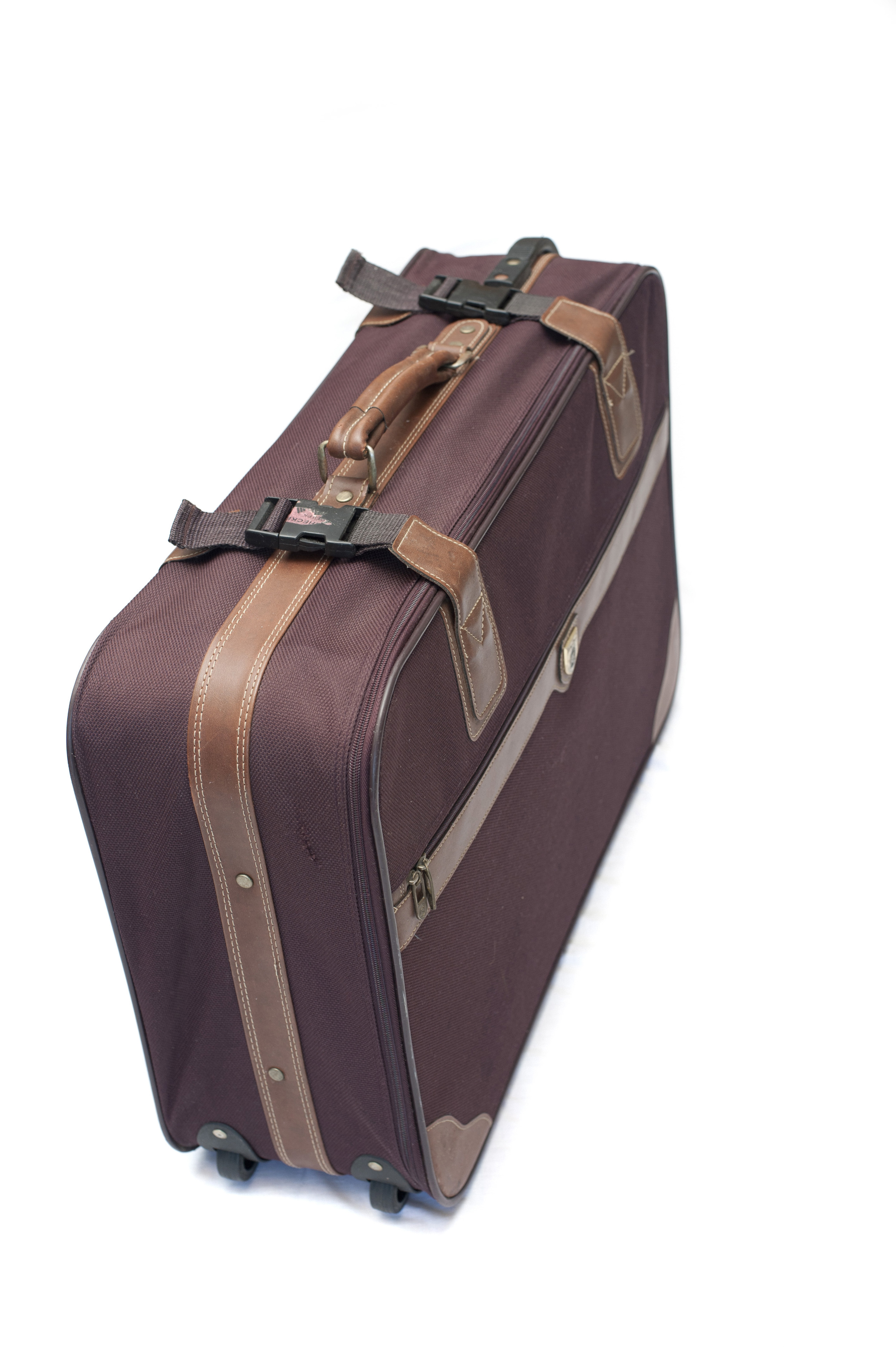 Unmarked brown suitcase, luggage or baggage, with straps and wheels conceptual of travel and vacations on white