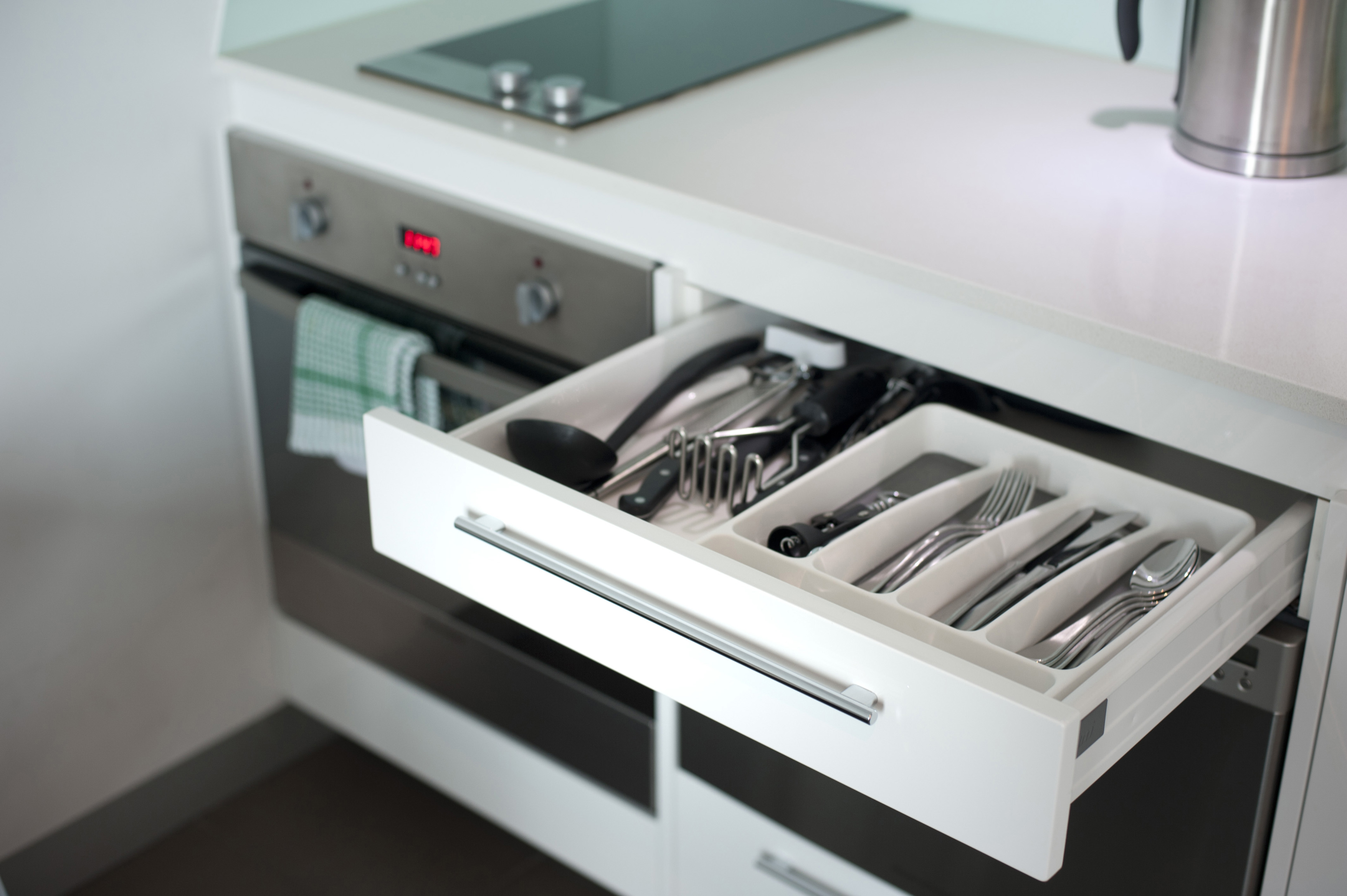 Image Of Open Cutlery Drawer In A Kitchen Cabinet