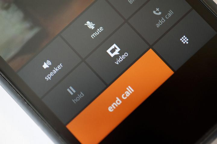 image of orange end call button on a black mobile phone